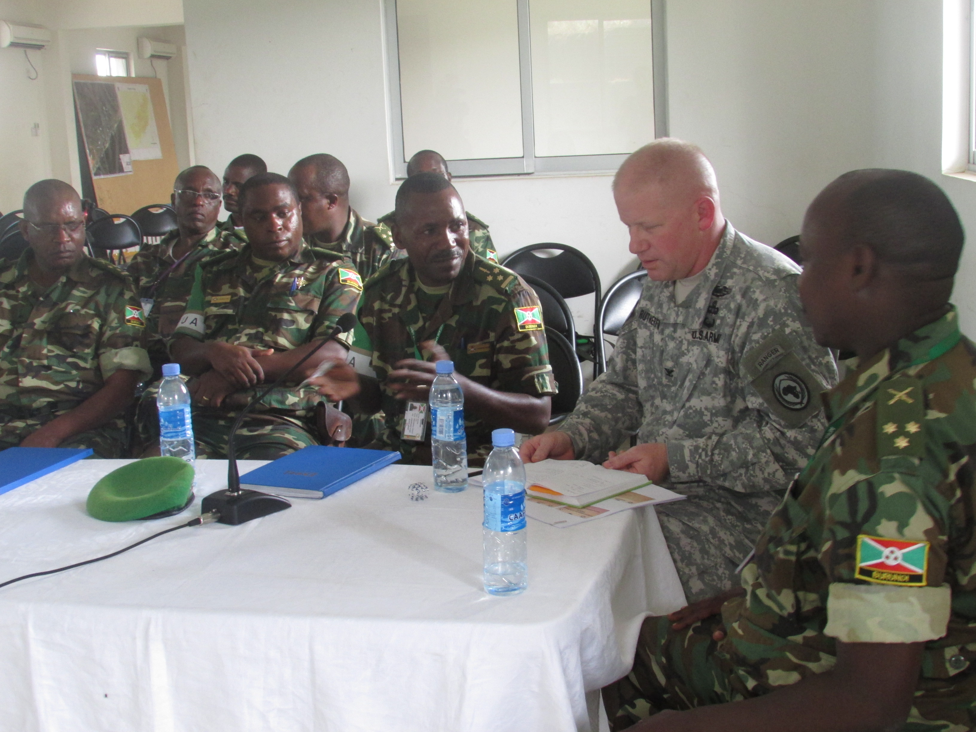 U.S. Army Col. Wilson Rutherford, right, U.S. Military Coordination Cell Mogadisu, discusses support requirements for a pending Burundi National Defense Force offensive during a visit to the African Union Mission in Somalia Sector 5 Headquarters located in northern Mogadishu.  AMISOM forces have been instrumental in helping Somali National Security Forces push the Al Qaeda-affiliated terror group, al Shabaab, out of much of southern Somalia including most major towns and cities. (BNDF Courtesy Photo)