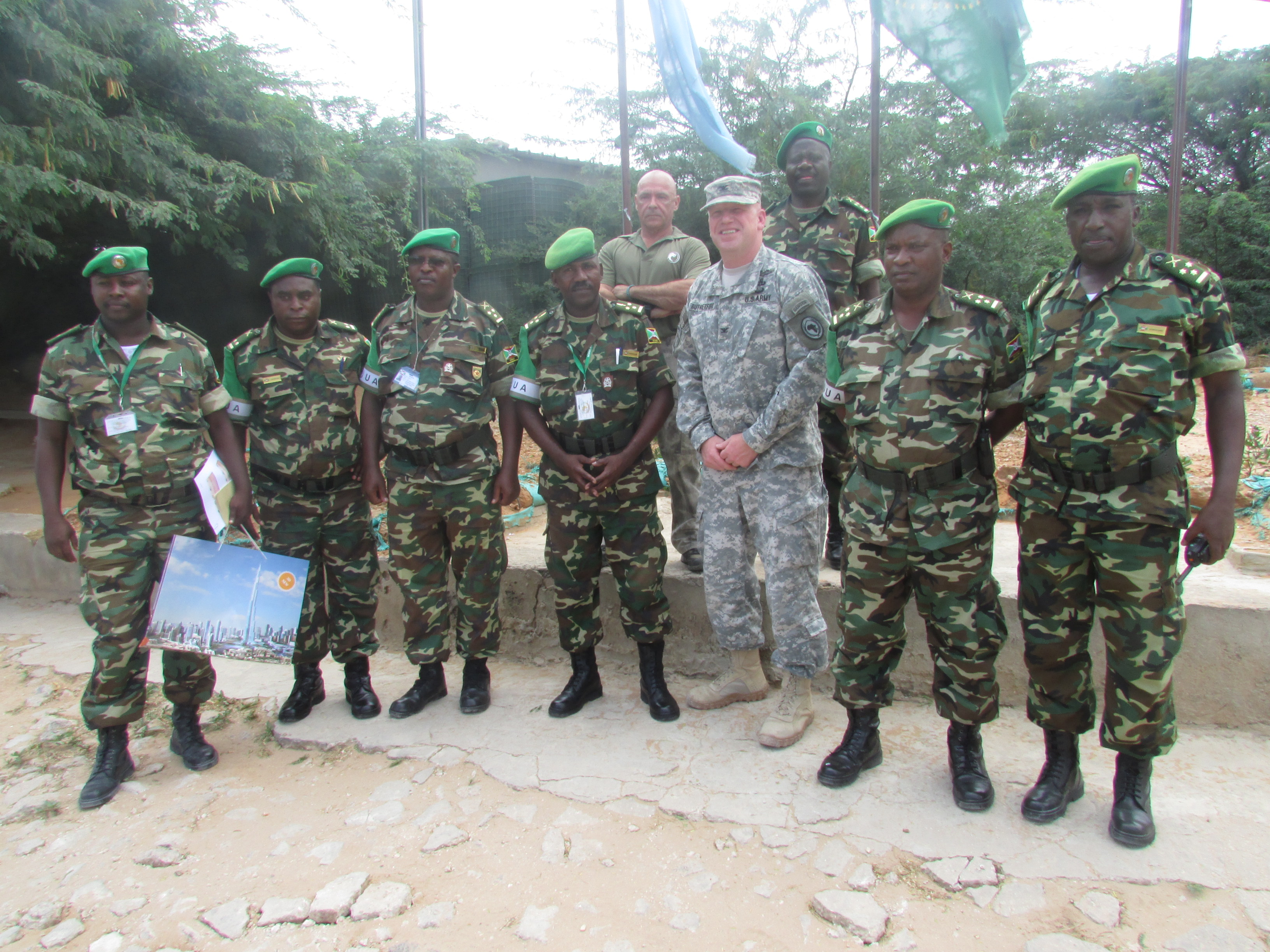 U.S. Army Col. Wilson Rutherford, center, U.S. Military Coordination Cell Mogadisu, visits with Burundi National Defense Forces at the African Union Mission in Somalia Sector 5 Headquarters located in northern Mogadishu. Burundian forces serving in AMISOM have been instrumental in creating a relatively secure environment which has allowed the Somali peace process to take root and allowed local population the opportunity to establish accountable local governing institutions. (BNDF Courtesy Photo)