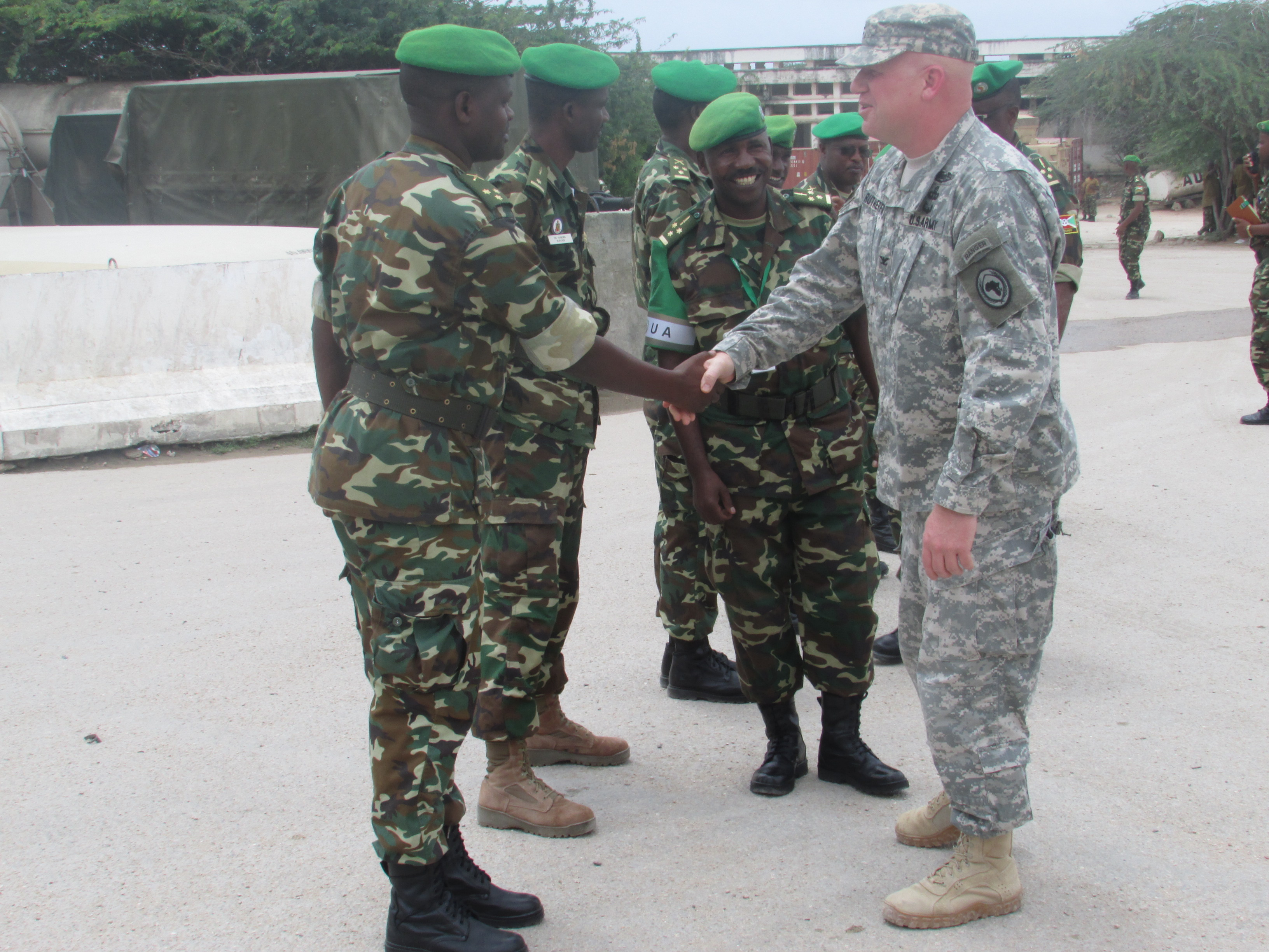 U.S. Army Col. Wilson Rutherford, right, U.S. Military Coordination Cell Mogadisu, meets with senior members of the Burundi National Defense Forces during a visit to the African Union Mission in Somalia Sector 5 Headquarters located in northern Mogadishu. Burundi is a major troop contributor to AMISOM, whose principal aim is to provide support for the Federal Government of Somalia in its efforts to stabilize the country and foster political dialogue and reconciliation. (BNDF Courtesy Photo)