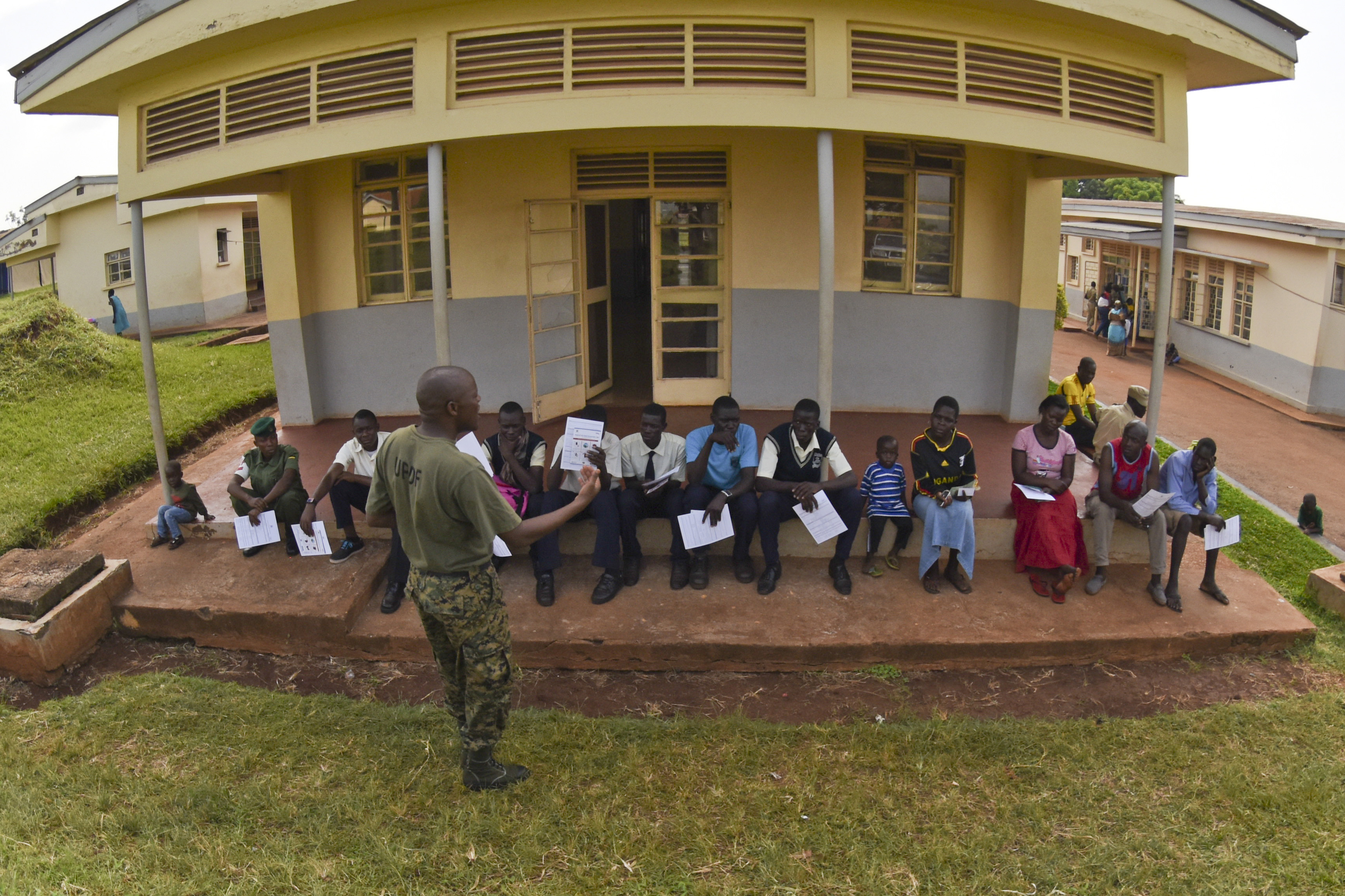 A UPDF soldier briefs students from a local school on medical procedures during MEDRETE 15-4 on September 21, 2015 in Jinja, Uganda.  This exercise focused on exchange of best practices strengthening U.S. strategic partnerships with UPDF to enhance readiness and interoperability. (U.S. Air Force photo by Master Sgt. Charlene M. Spade)
