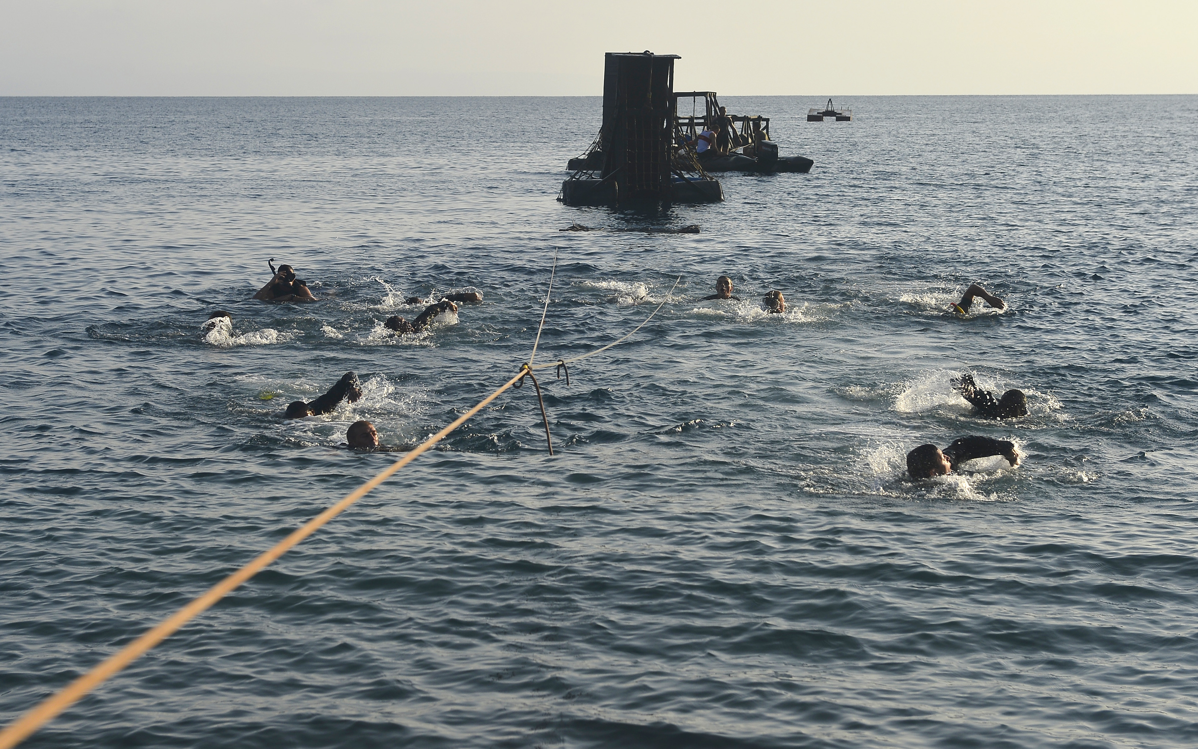 "U.S. and French service members swim towards shore to complete the water obstacles course during the French Desert Survival Course, near Arta Beach, Djibouti, Sept. 30, 2015. In addition to survival tactics, service members teamed up to complete a water obstacle course and the ""Path of the Unconscious,"" a ropes course carved out of an approximately 300 foot high cliff. (U.S. Air Force photo by Senior Airman Nesha Humes)"