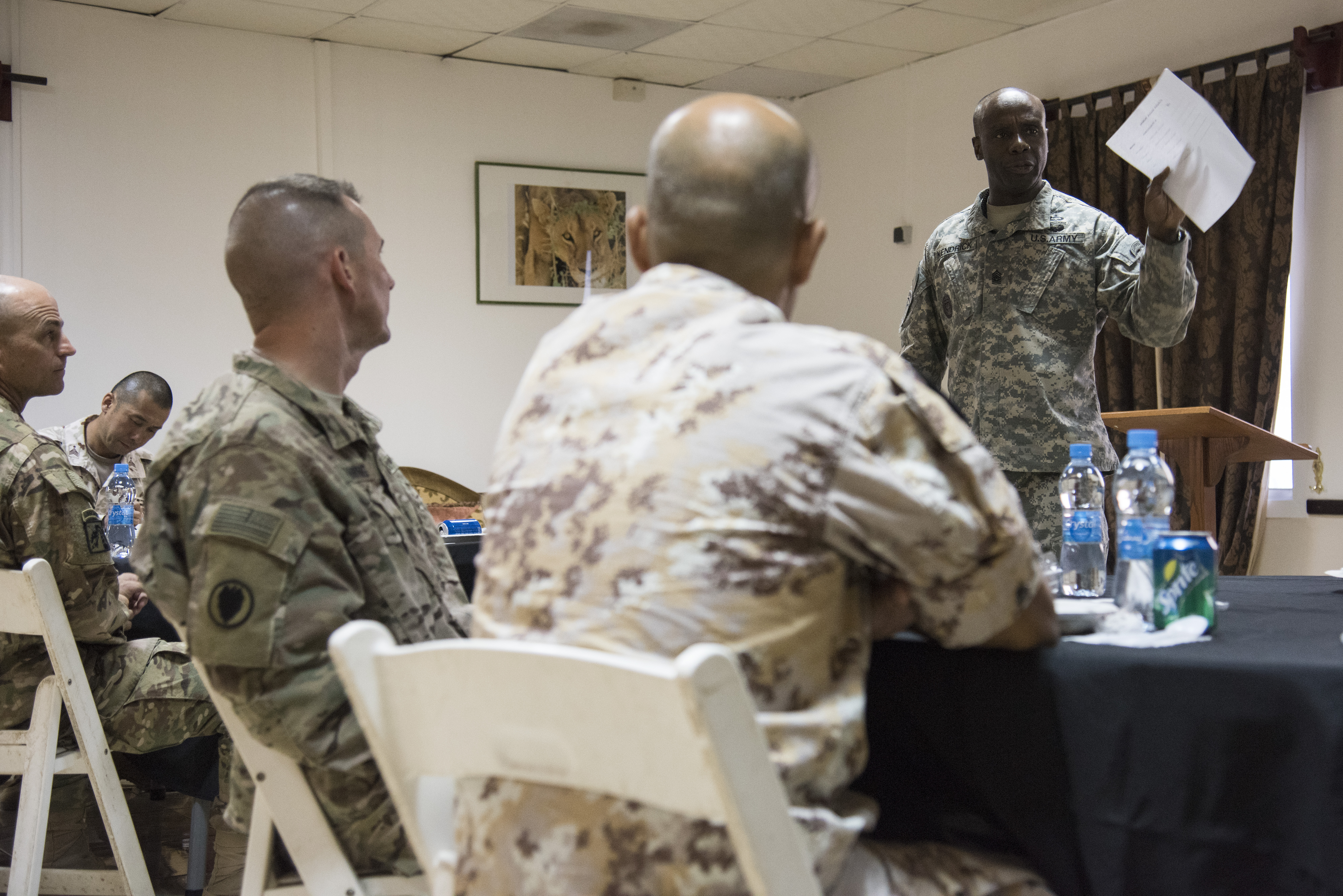 U.S. Army Command Sgt. Major Butler Kendrick, Combined Joint Task Force-Horn of Africa (CJTF-HOA) senior enlisted leader (SEL), speaks with Joint Forces Senior Enlisted Leader Professional Development (JFSELPD) course attendees at Camp Lemonnier, Djibouti, Oct.1, 2015. Kendrick developed the course as a means for SELs on CJTF-HOA and Camp Lemonnier to build fellowship and camaraderie with each other across services and countries. (U.S. Air Force photo by Staff Sgt. Nathan Maysonet)