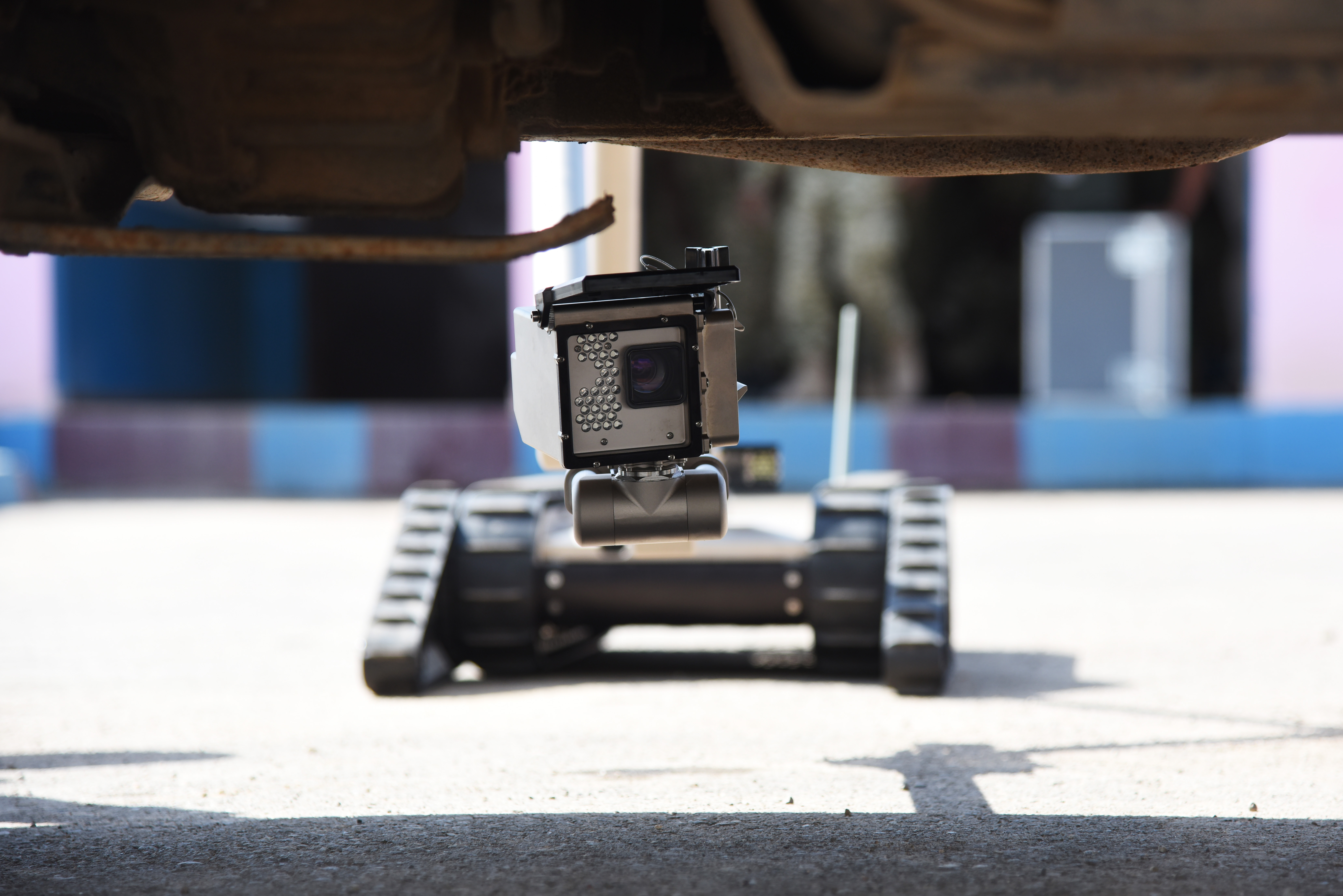 An iRobot 510 Packbot searches for explosive devises under a vehicle during a course in Djibouti, Oct. 12, 2015. Djibouti Armed Forces (FAD) service members and explosive ordnance disposal technicians assigned to Camp Lemonier learned how to operate the robot. (U.S. Air Force photo by Staff Sgt. Maria Bowman)