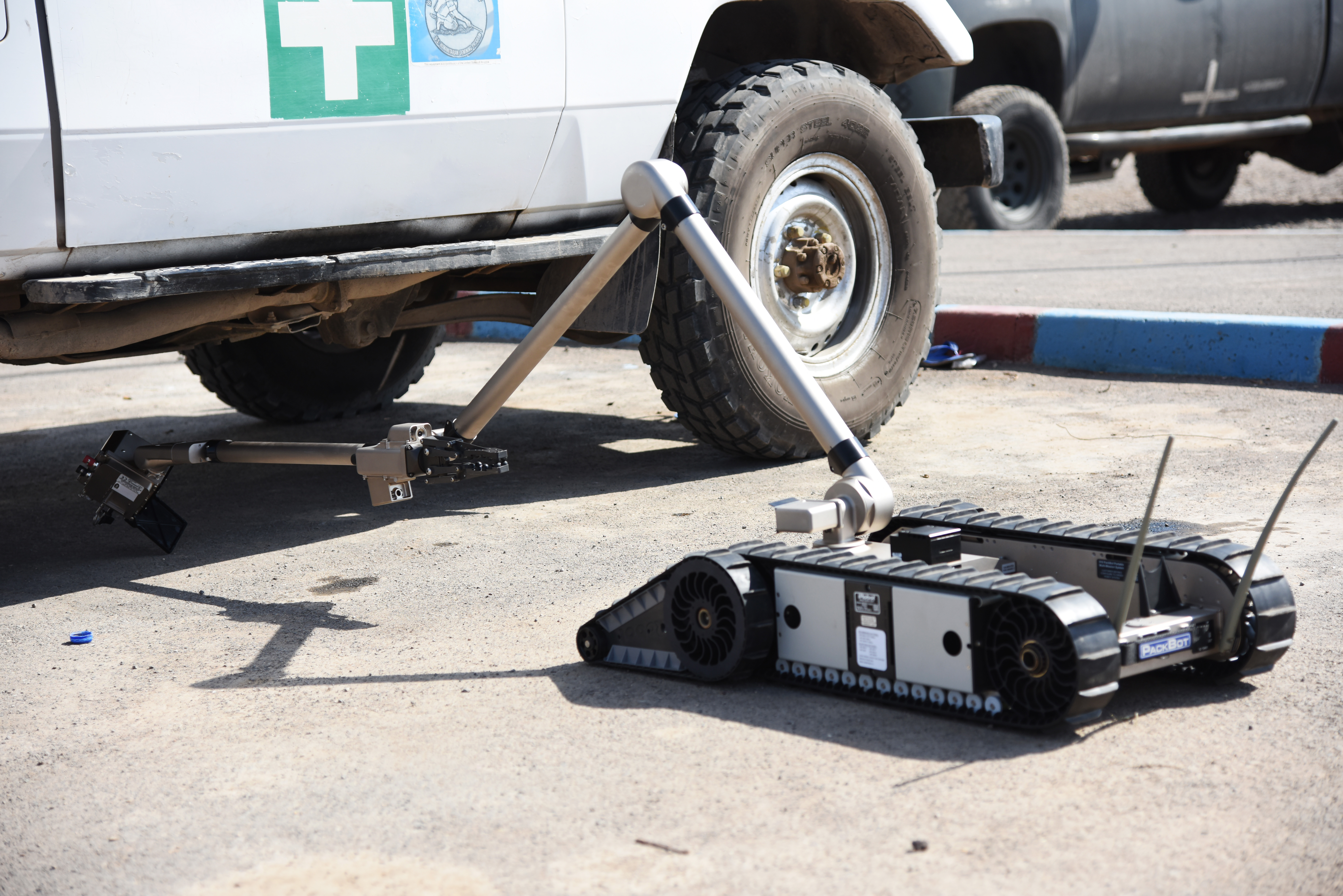 An iRobot 510 Packbot searches for explosive devices under a vehicle during a training course in Djibouti, Oct. 12, 2015. Djibouti Armed Forces (FAD) service members and explosive ordnance disposal technicians assigned at Camp Lemonier learned how to operate the robot. (U.S. Air Force photo by Staff Sgt. Maria Bowman)