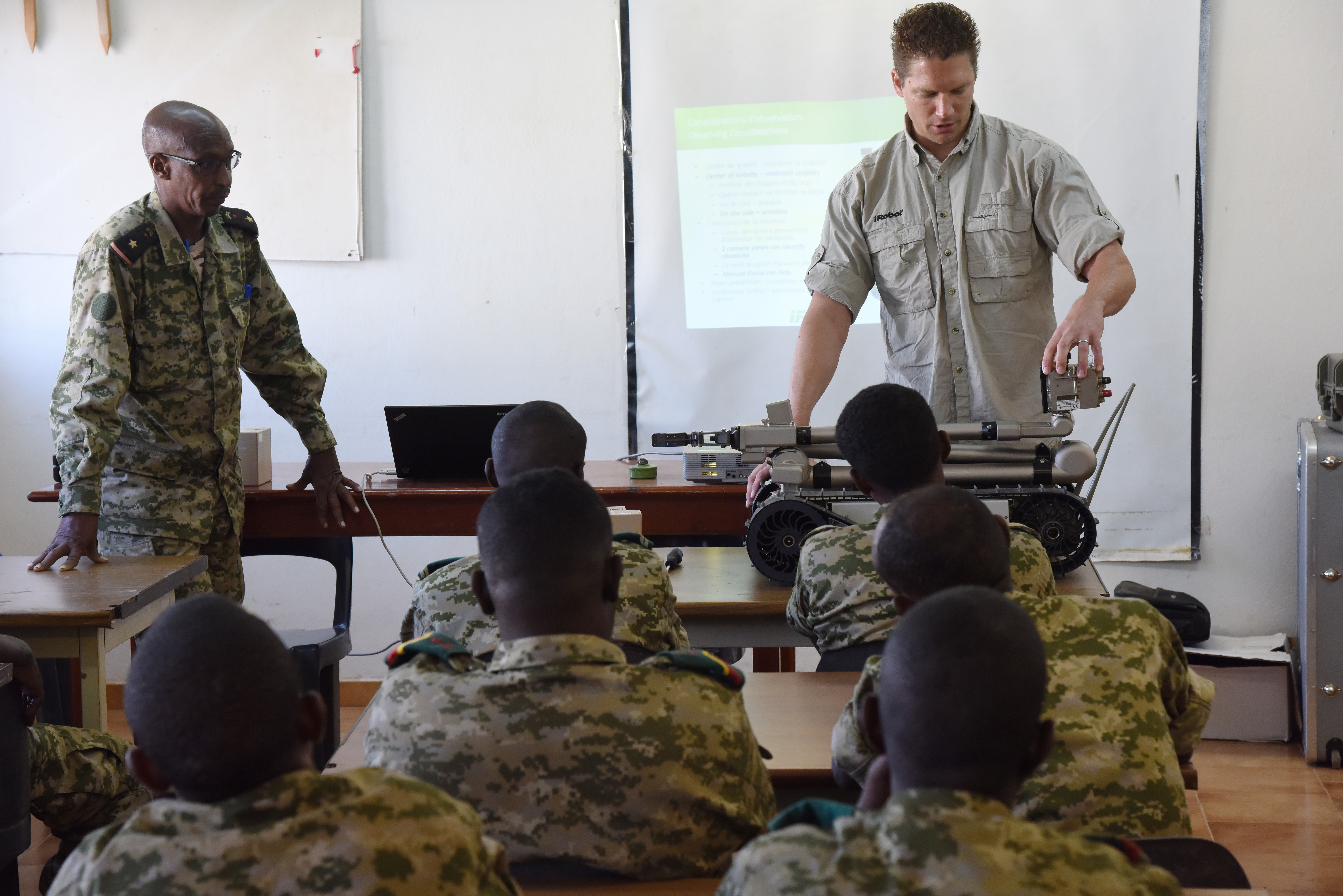 Joseph Brunette, iRobot instructor, leads a class on the 510 Packbot to Djibouti Armed Forces (FAD) service members Oct. 12, 2015 in Djibouti.  The robot can perform bomb disposal, surveillance and reconnaissance operations.  (U.S. Air Force photo by Staff Sgt. Maria Bowman)