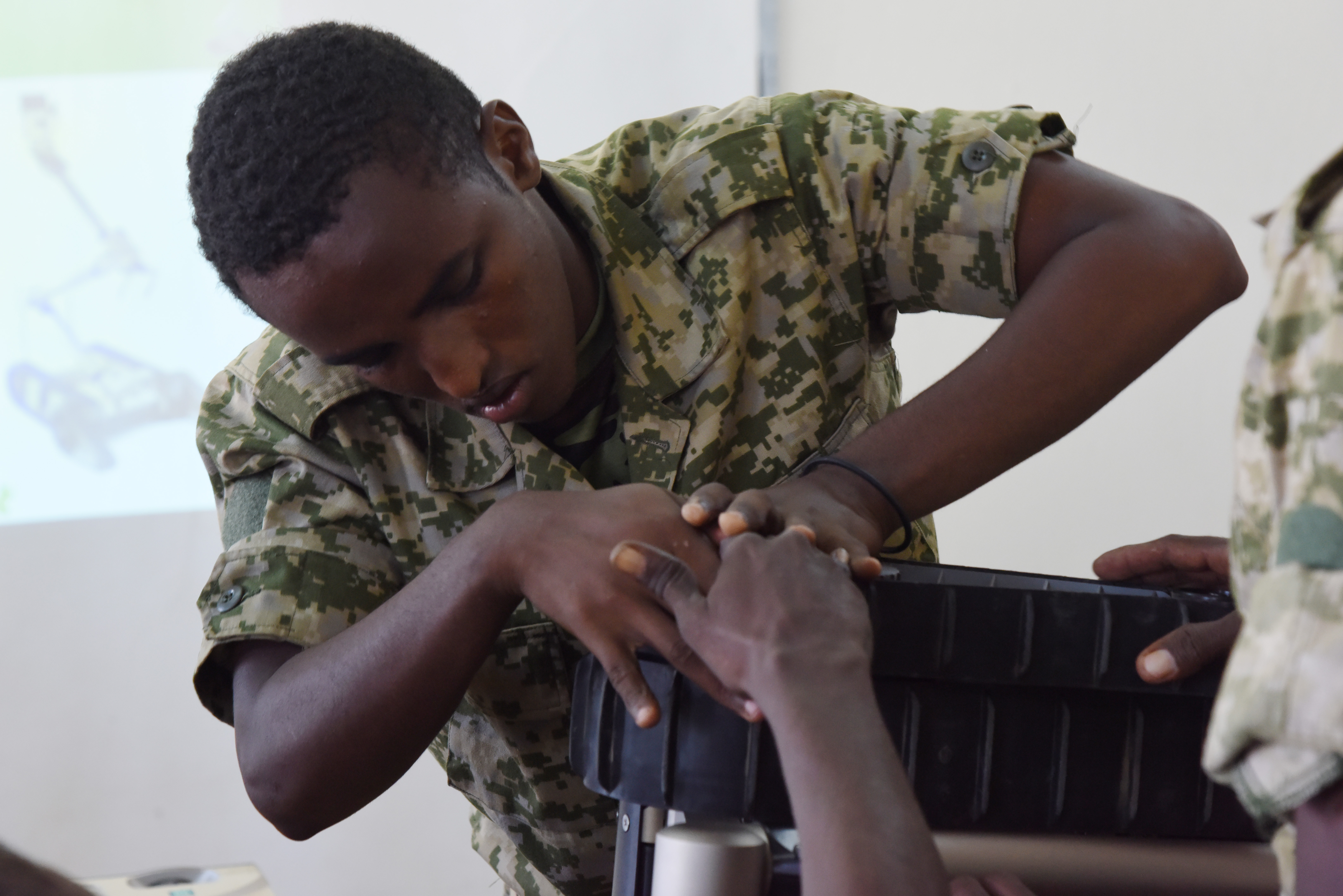Members of the Djibouti Armed Forces (FAD) learn how set up the iRobot 510 Packbot during a class in Djibouti, Oct. 12, 2015. The service members also learned how to use the robot to search under vehicles for explosive devices. (U.S. Air Force photo by Staff Sgt. Maria Bowman)