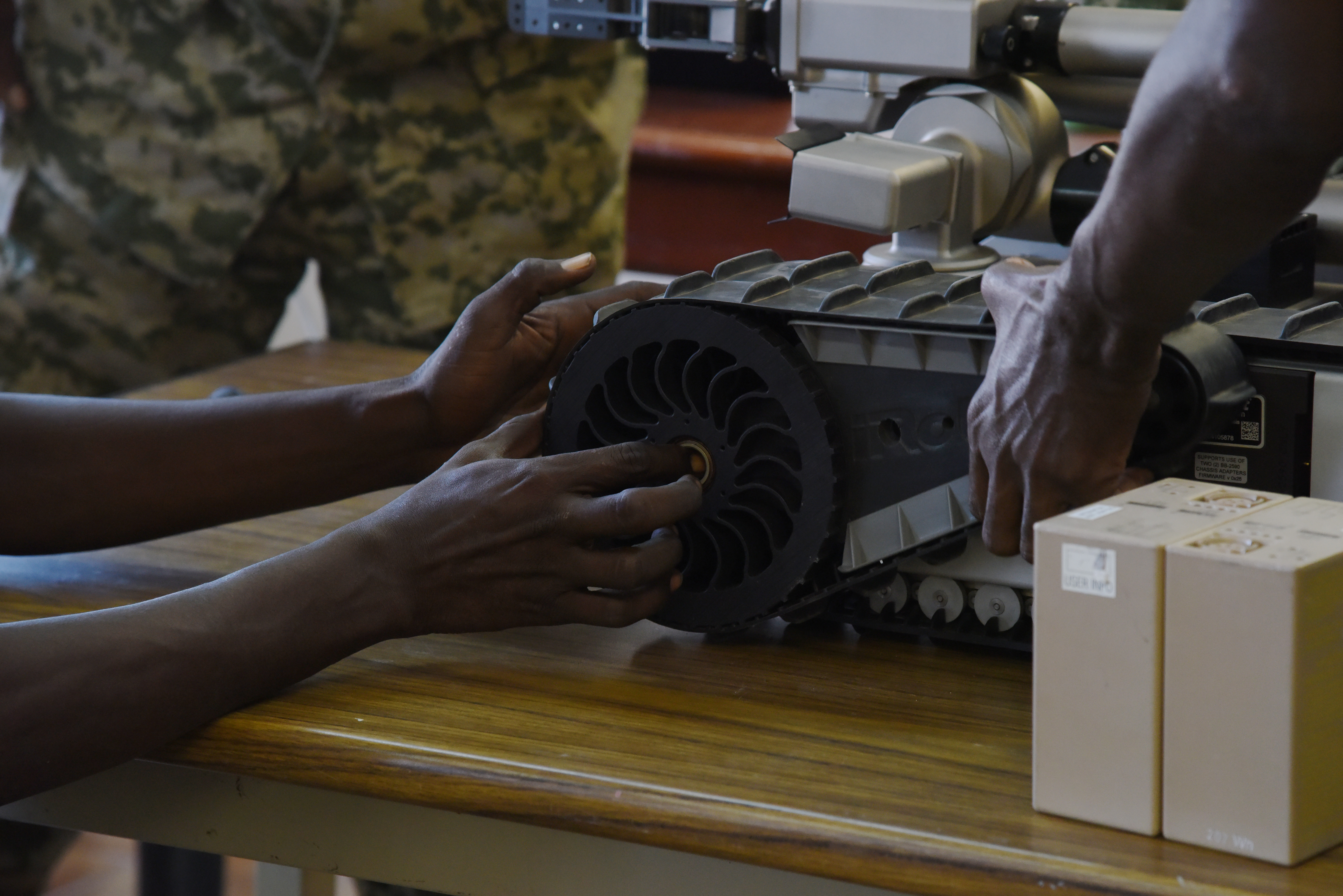 Members of the Djibouti Armed Forces (FAD) learn how set up the iRobot 510 Packbot during a class in Djibouti, Oct. 12, 2015. Service members also learned how to use the robot to search under vehicles for explosive devices. (U.S. Air Force photo by Staff Sgt. Maria Bowman)