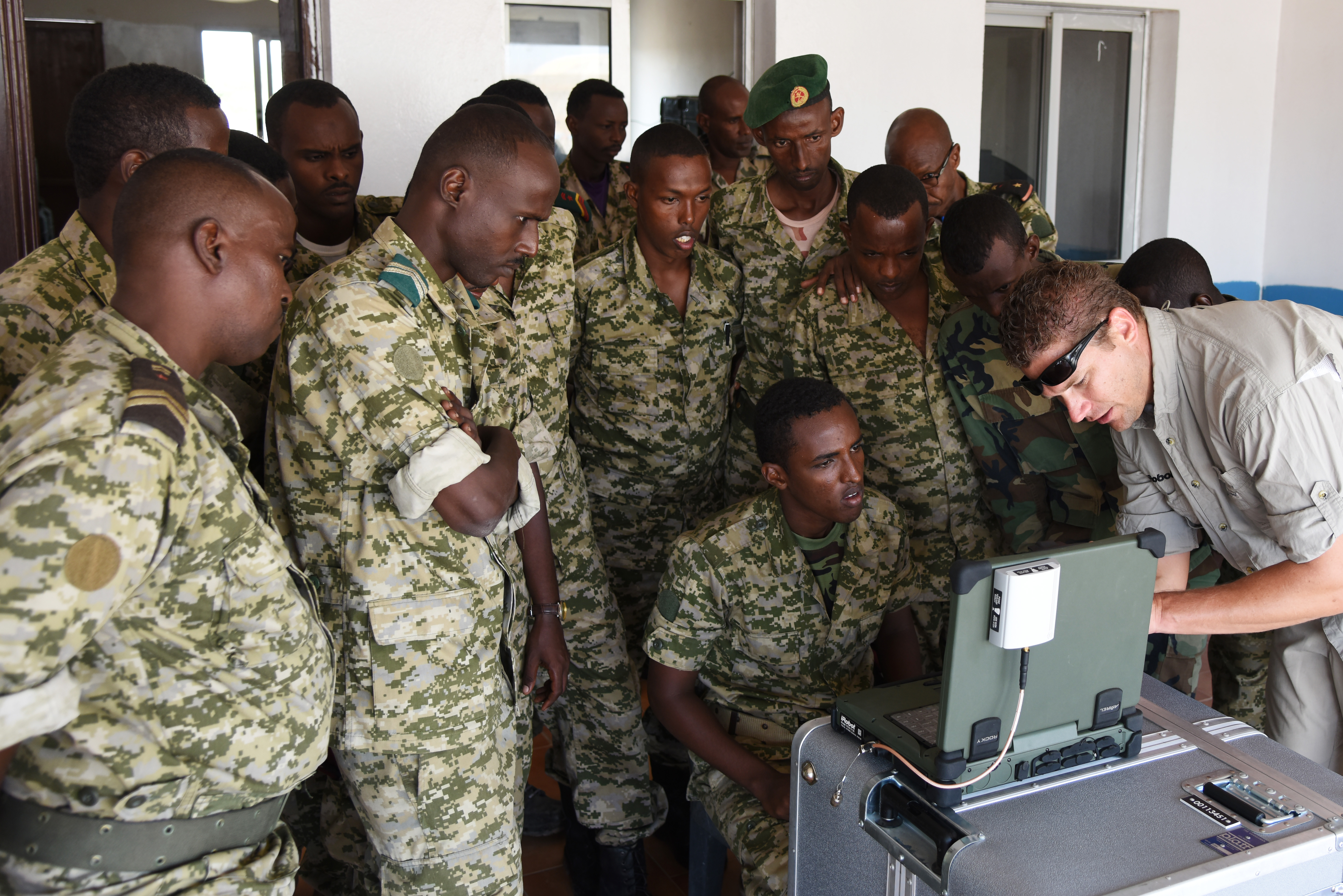 Joseph Brunette, iRobot instructor, shows Djibouti Armed Forces (FAD) service members how to use a computer to monitor what the 510 Packbot is searching. The robot searches for, and dispose of, explosive weapons. (U.S. Air Force photo by Staff Sgt. Maria Bowman)
