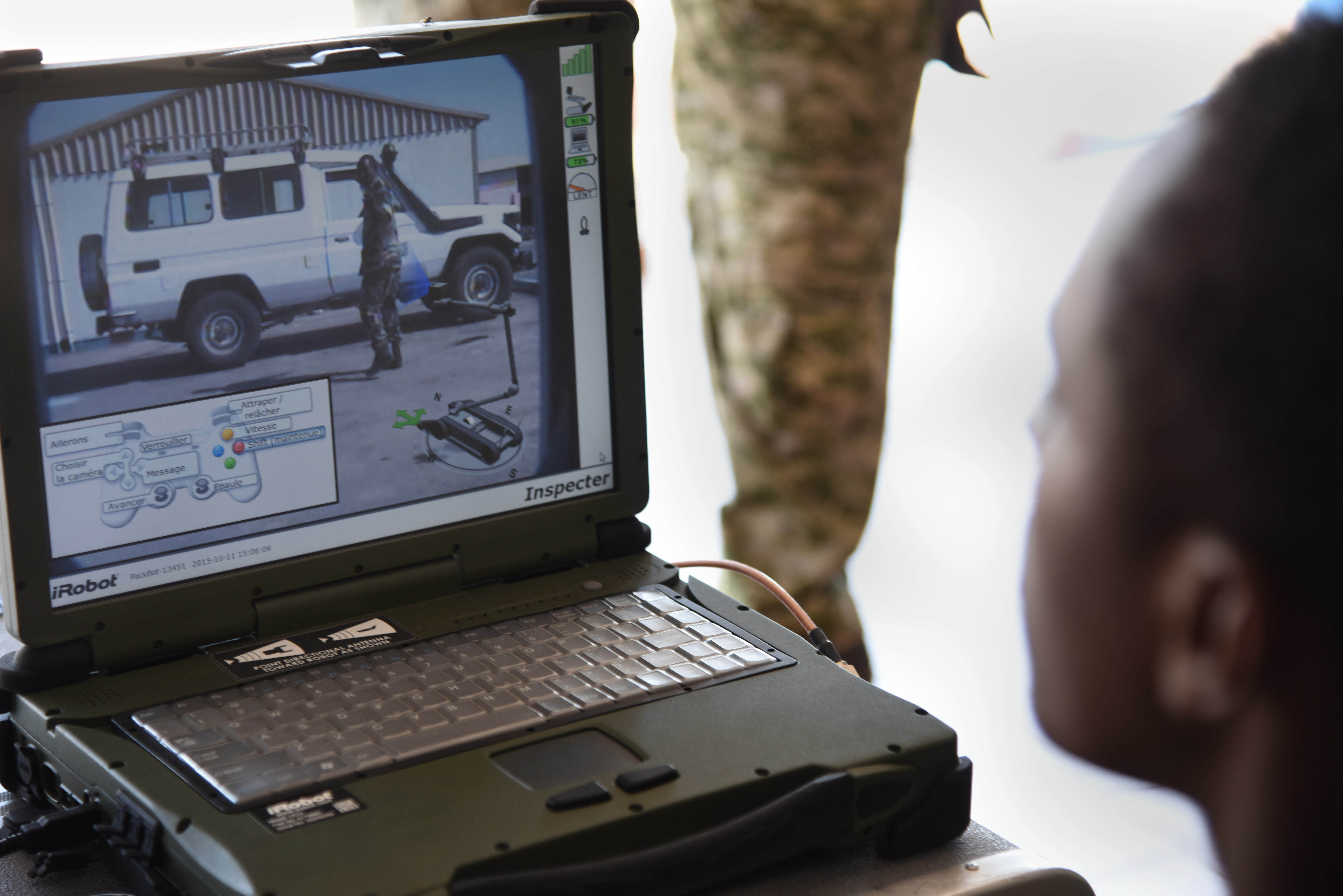 Members of the Djibouti Armed Forces (FAD) monitor a computer transmitting video from the iRobot 510 Packbot Oct. 12, 2015, in Djibouti.  The robot can perform bomb disposal, surveillance and reconnaissance operations.  (U.S. Air Force photo by Staff Sgt. Maria Bowman)
