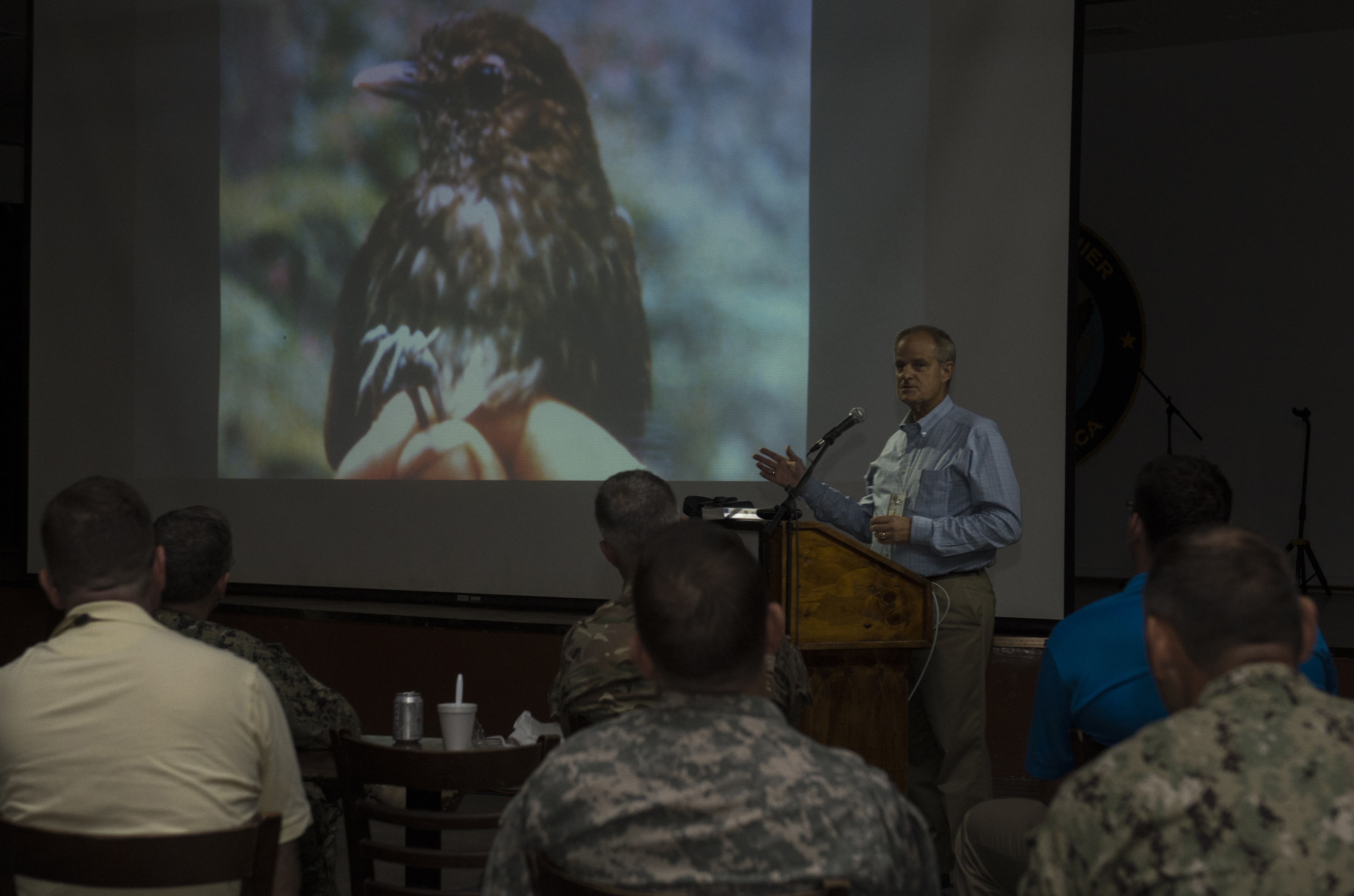 Peter Kaestner, Combined Joint Task Force-Horn of Africa political advisor, describes Grallaria Kaestneri during a presentation Oct. 9, 2015, at Camp Lemonnier, Djibouti. While living in Colombia, Kaestner heard a birdcall that was unknown. He tracked and located the bird, which was an undiscovered species. (U.S. Air Force photo by Senior Airman Peter Thompson/Released)