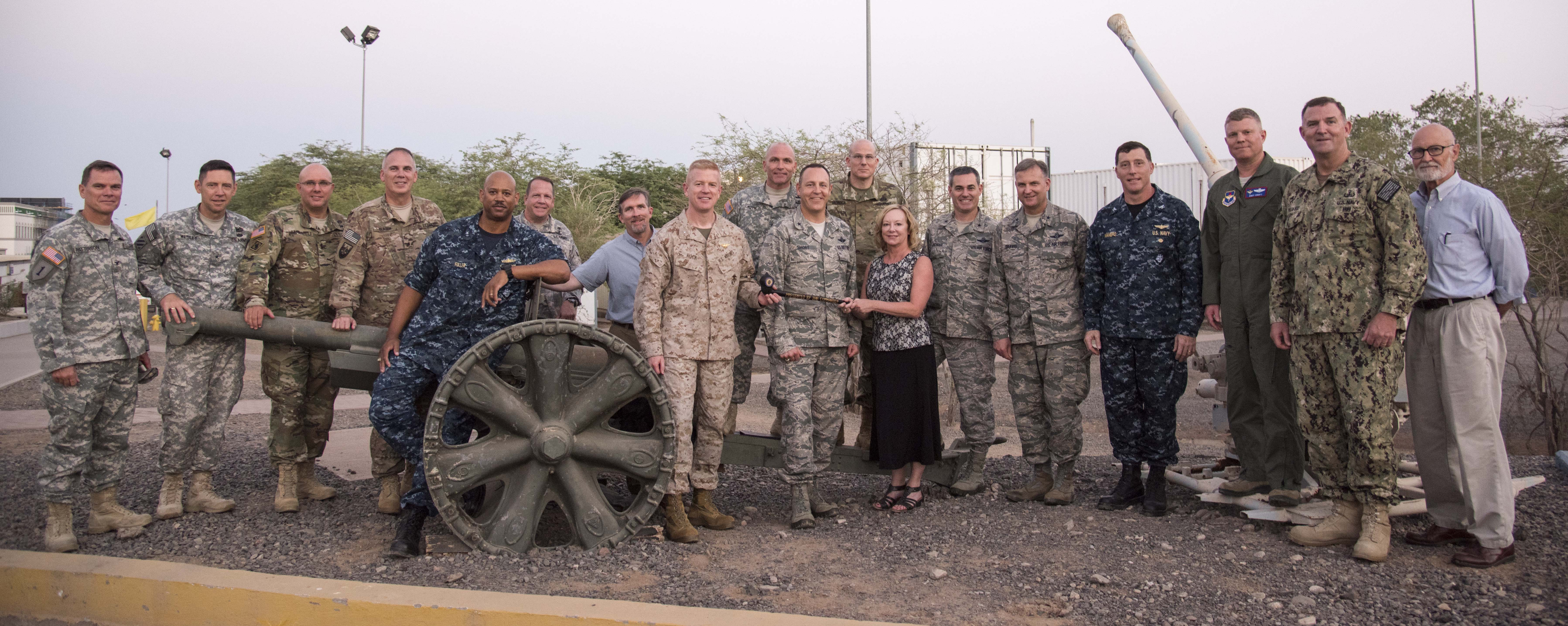 Fellows from the 2016-1 CAPSTONE course gather at the end of their tour of Camp Lemonnier, Djibouti, Oct. 14, 2015. The five-week CAPSTONE curriculum examines major issues affecting national security decision making, military strategy, joint/combined doctrine, interoperability, and key allied nation issues.  (U.S. Air Force photo by Staff Sgt. Victoria Sneed)