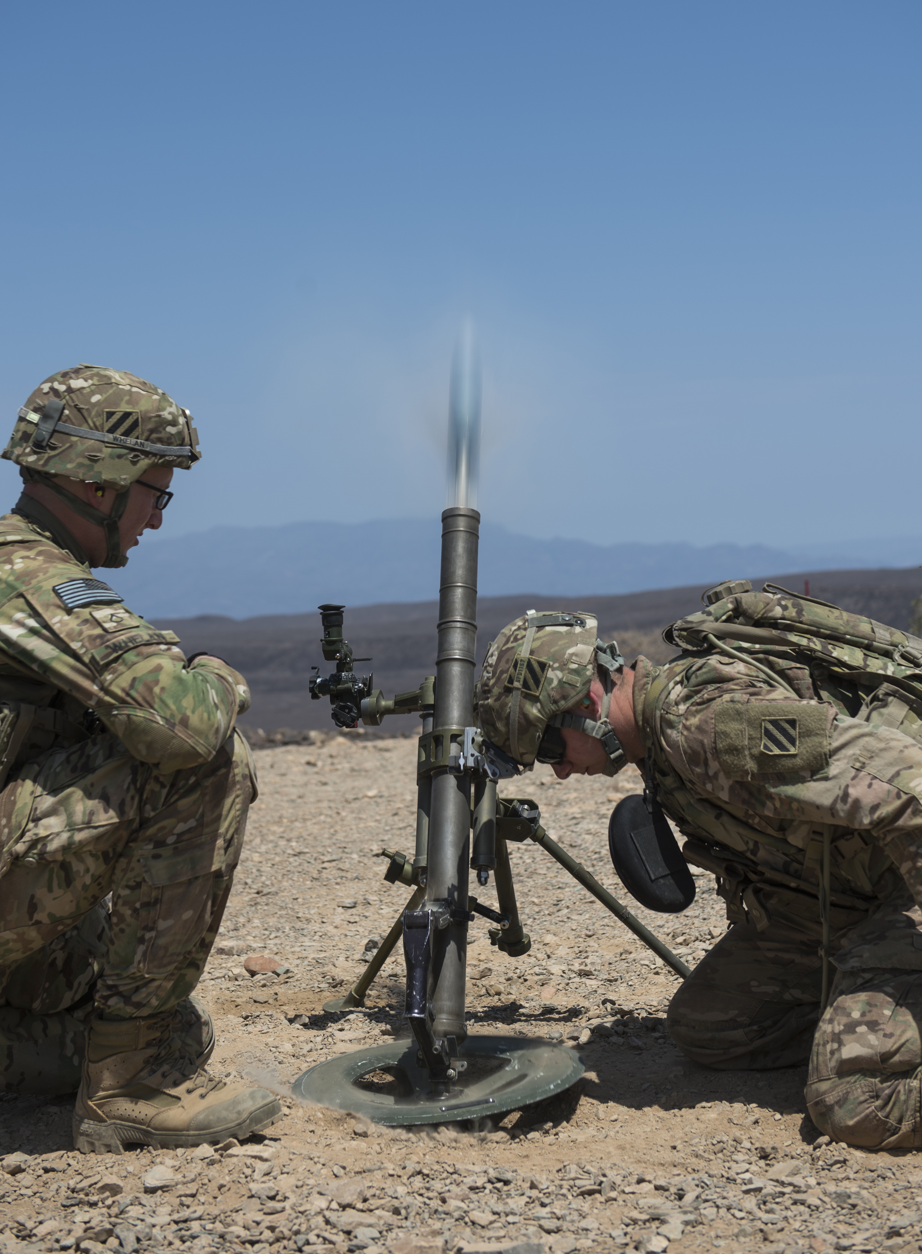 U.S. Army Pfc. Stephan Whelan, mortar gunner, left, and Spc. Steven Doherty, both assigned to Alpha Company, 3rd Battalion, 15th Infantry Regiment, operate a M224 60mm mortar launcher during a training scenario Oct. 12, 2015, in Arta, Djibouti. ACO operates using light infantry and various other force enablers to accomplish their mission. (U.S. Air Force photo by Senior Airman Peter Thompson/Released)