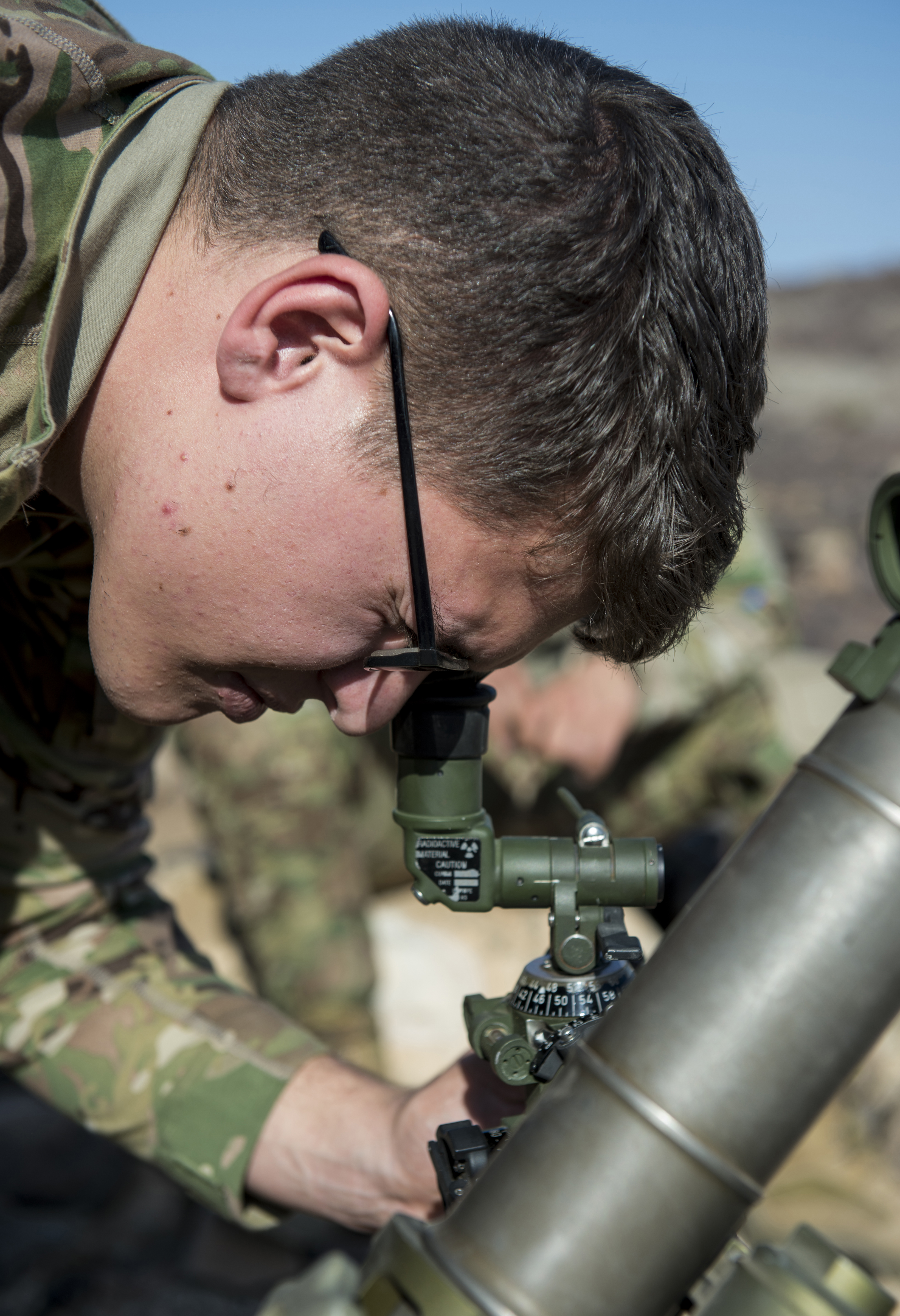U.S. Army Spc. Tyler Rodriguez, Alpha Company, 3rd Battalion, 15th Infantry Regiment mortar gunner, aligns sights on a M224 60mm mortar launcher October 12, 2015, in Arta, Djibouti. Alpha Company operates using light infantry and various other force enablers, which operate together cohesively to accomplish their mission. (U.S. Air Force photo by Senior Airman Peter Thompson/Released)