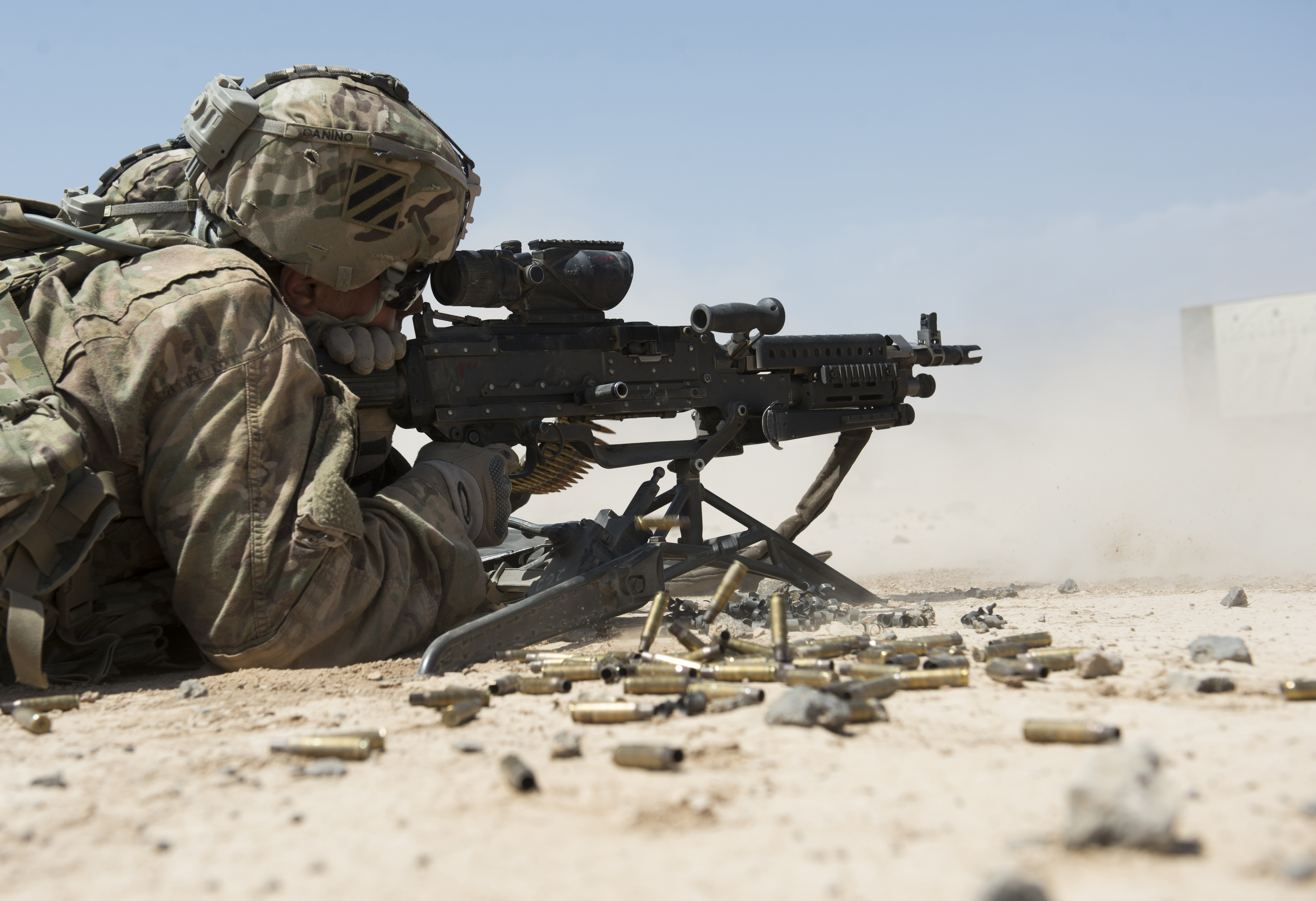 U.S. Army Pfc. George Canino, Alpha Company, 3rd Battalion, 15th Infantry Regiment M240 gunner, fires a M240L during weapons qualification Oct. 14, 2015, in Arta, Djibouti. Opportunities like the weapons density live fire course enable soldiers to become experts with their weapons systems through meticulous preparation and training. (U.S. Air Force photo by Senior Airman Peter Thompson/Released)