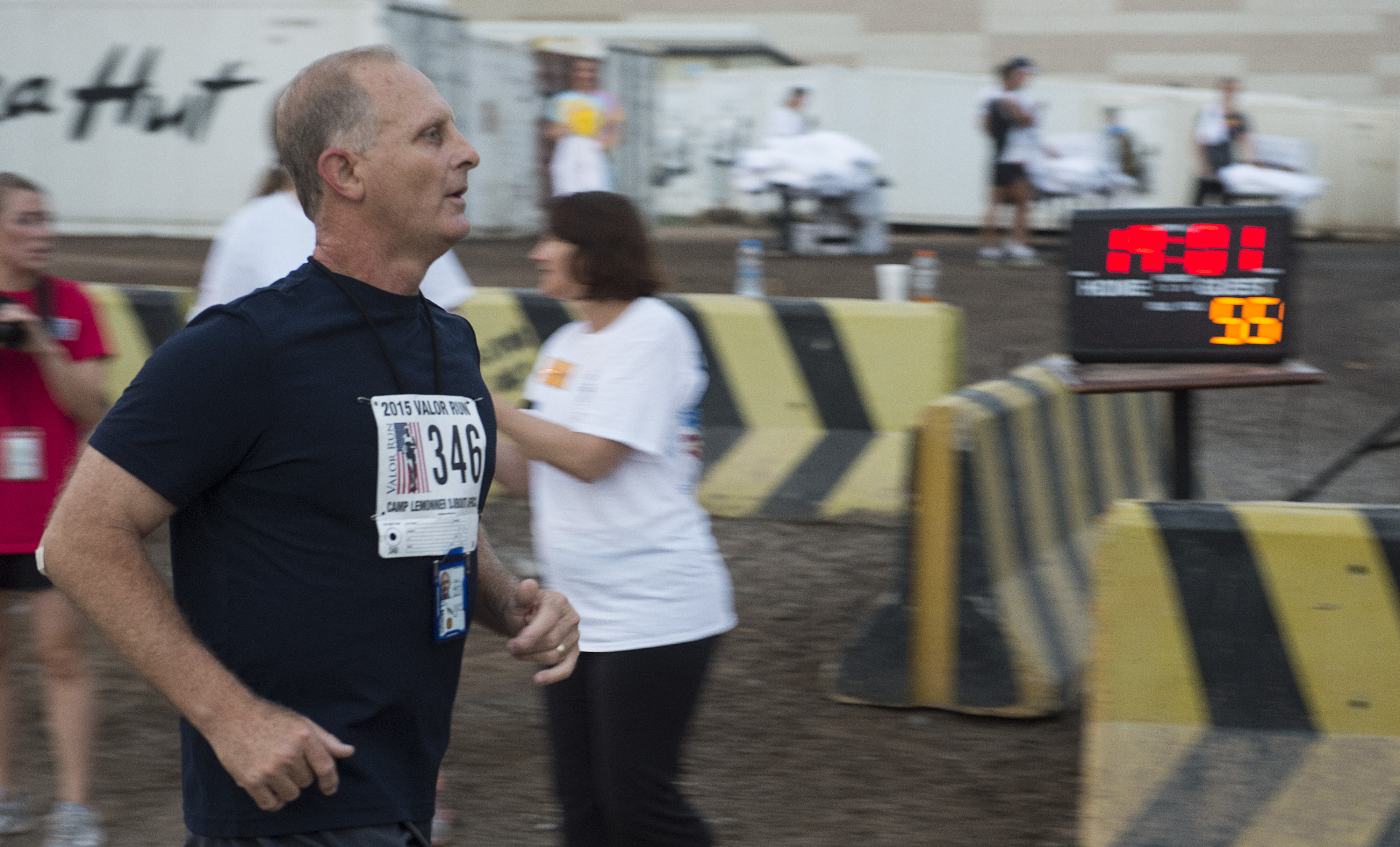 A Valor Run participant crosses the finish line Oct. 21, 2015, at Camp Lemonnier, Djibouti. More than 800 members of Combined Joint Task Force-Horn of Africa and Camp Lemonnier ran a 5K or walked a 3K course in remembrance of fallen female service members. (U.S. Air Force photo by Senior Airman Peter Thompson/Released)