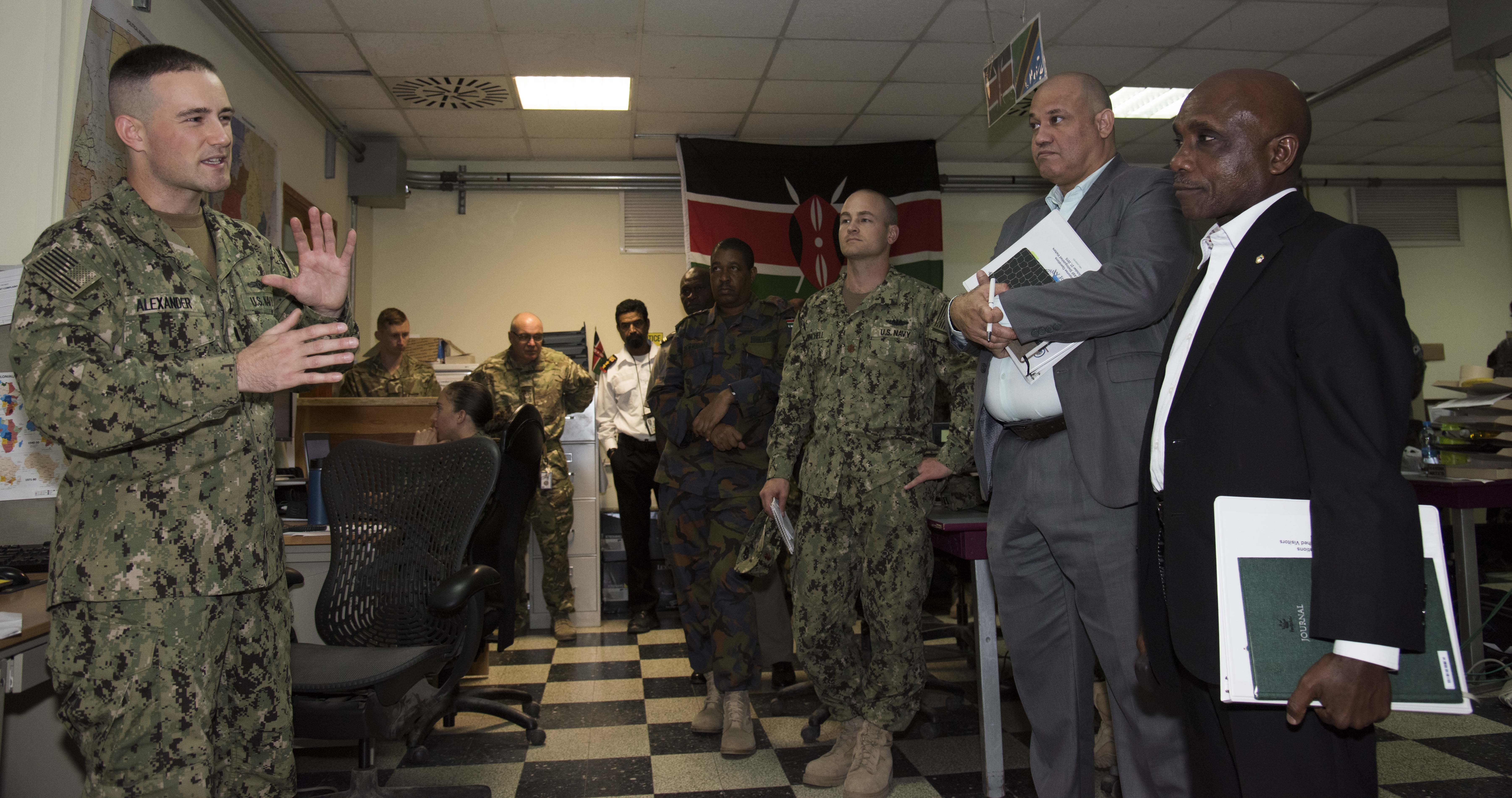 Ambassador Issimail Chanfi, Eastern Africa Standby Force (EASF) director, receives an introduction to the Fusion Action Cell Oct. 27, 2015 at Camp Lemonnier, Djibouti. The FAC is comprised of service members from the U.S., Europe and East Africa working together to setup military-to-military projects and civilian support initiatives in partner countries throughout the Horn of Africa. (U.S. Air Force photo by Staff Sgt. Victoria Sneed)