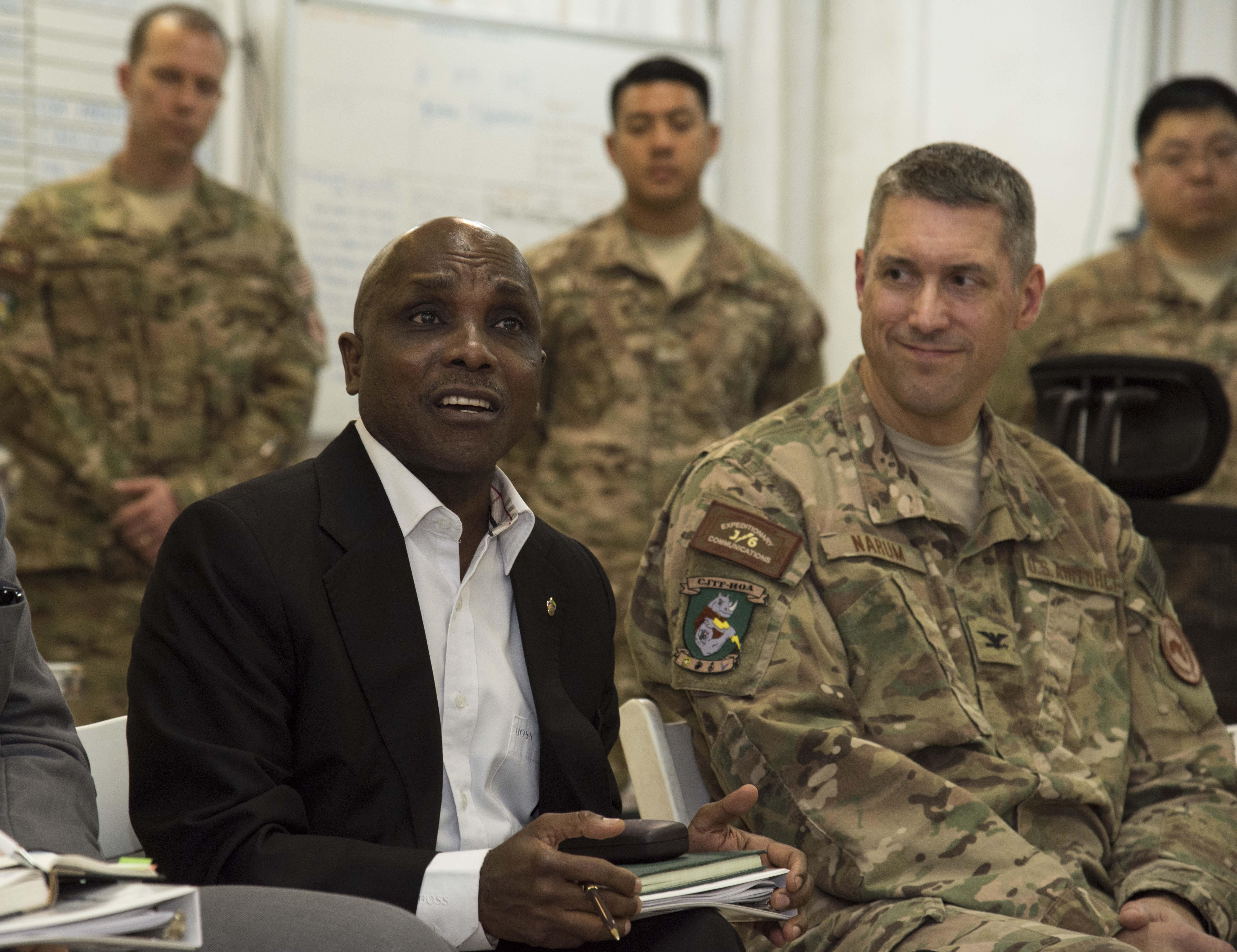 Ambassador Issimail Chanfi, Eastern Africa Standby Force (EASF) director, speaks to Airmen from the Combined Joint Task Force-Horn of Africa's Tactical Communications Directorate Oct. 27, 2015 at Camp Lemonnier, Djibouti. Chanfi was shown available strategies for communication in remote locations or those affected by disaster where infrastructures are damaged. (U.S. Air Force photo by Staff Sgt. Victoria Sneed)
