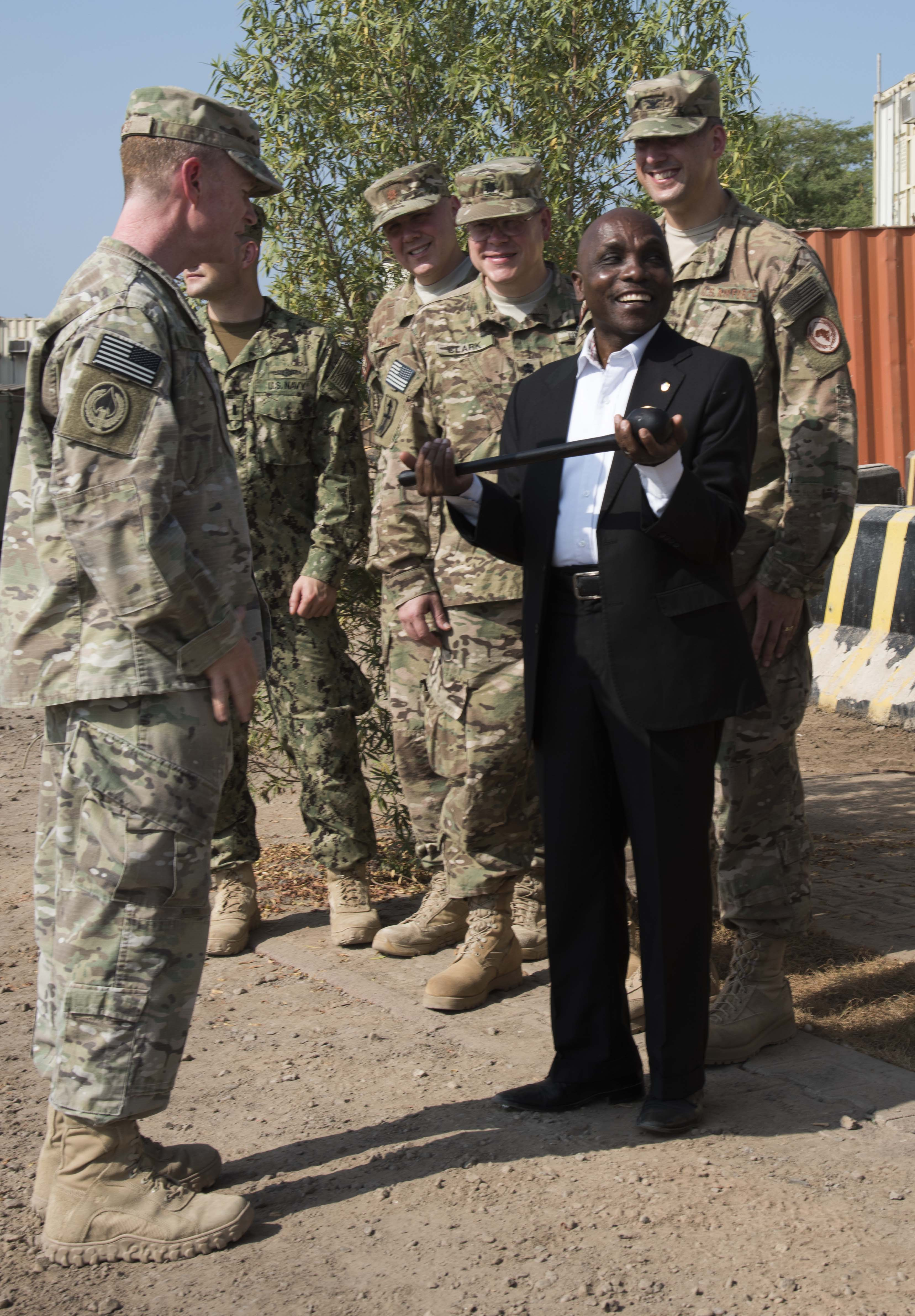 Ambassador Issimail Chanfi, Eastern Africa Standby Force (EASF) director, receives a rungu stick from Brig. Gen. William West, Combined Joint Task Force-Horn of Africa deputy commander, Oct. 27, 2015 at Camp Lemonnier, Djibouti. In the East African Maasai culture, the rungu is an important emblem of warrior status. (U.S. Air Force photo by Staff Sgt. Victoria Sneed)