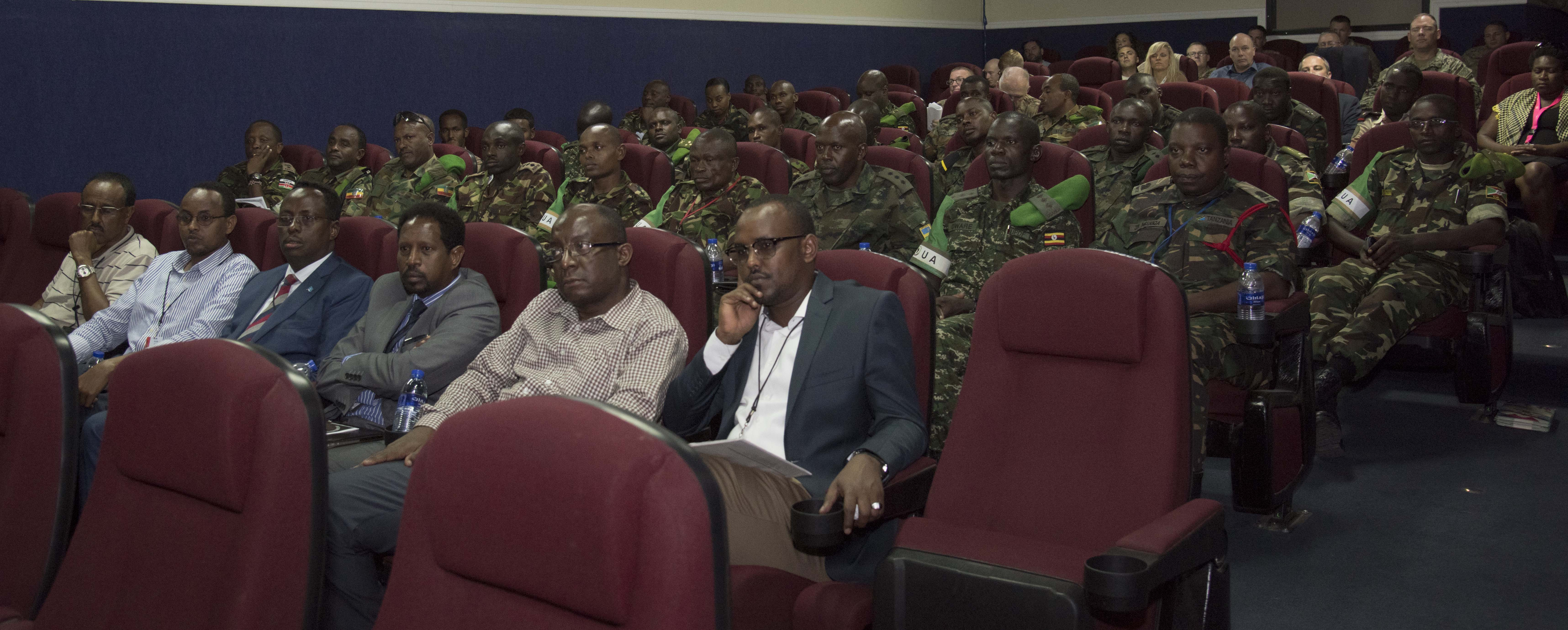 Members from the African Union Mission to Somalia and representatives from other partner nations listen to a presentation at the Public Information Officer Conference hosted by Combined Joint Task Force-Horn of Africa at Camp Lemonnier, Djibouti, Nov. 4, 2015. The conference provided attendees a better understanding of how interaction with their audiences aids mission success.