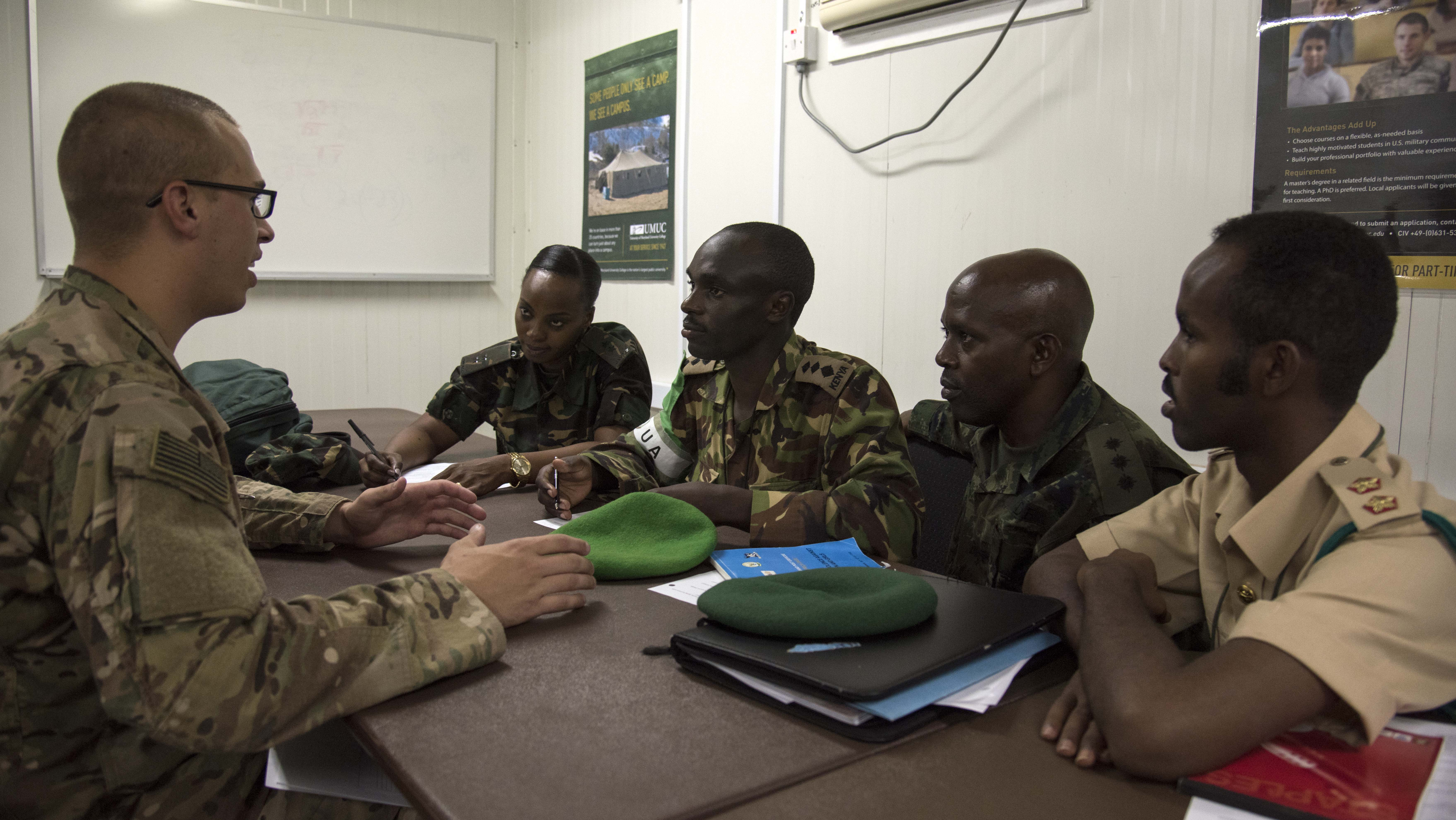 Multinational members from partner nations practice conversing with simulated local media during the Public Information Officer Conference, hosted by Combined Joint Task Force-Horn of Africa, at Camp Lemonnier, Djibouti, Nov. 4, 2015. The goal of the exercise was to learn how building a report with media members allows for positive future interactions.