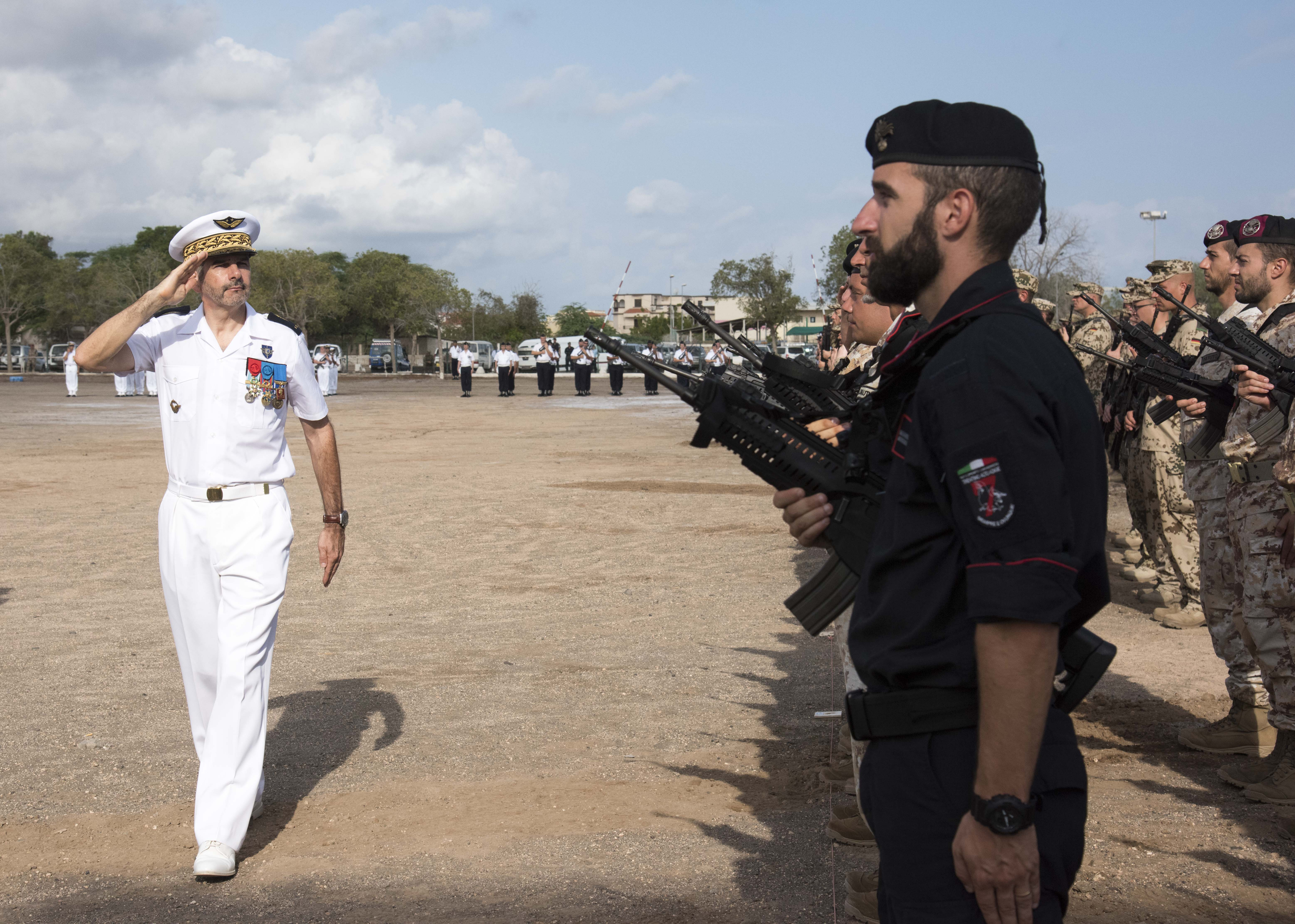 French Air Force Brig. Gen. Phillip Montocchio, salutes while reviewing troops during the Armistice Day ceremony at the French Marine Base, Nov. 11, 2015. Montocchio is the commanding officer for all French forces in Djibouti and was the officiating officer for the event.
