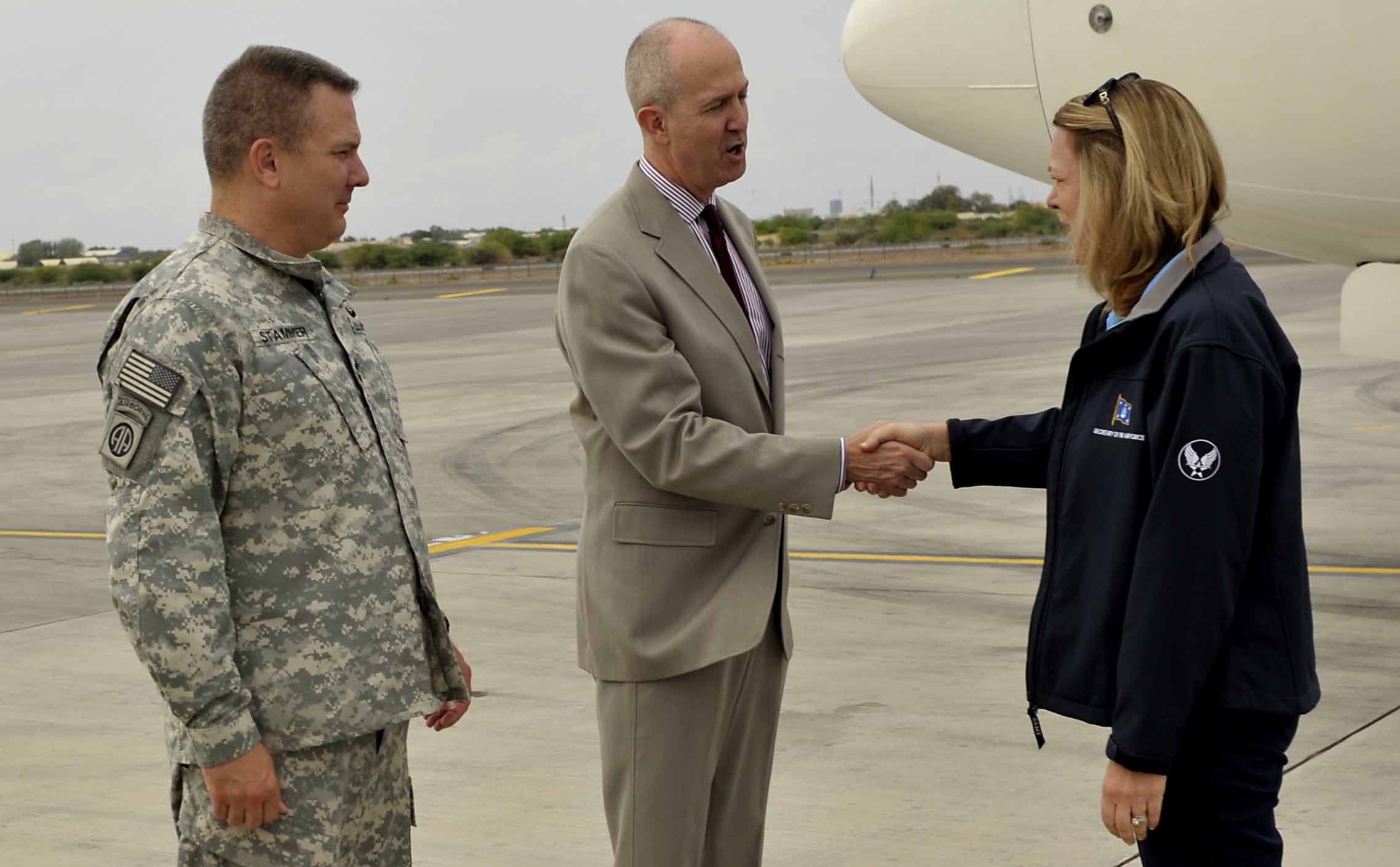 Secretary of the Air Force Deborah Lee James is greeted by Amb. Tom Kelly, U.S. Ambassador to the Republic of Djibouti and Maj. Gen. Mark Stammer, Combined Joint Task Force – Horn of Africa commander, upon arrival at Camp Lemonnier, Nov.12, 2015. James met with the ambassador, senior leaders from Camp Lemonnier and CJTF-HOA as well as Airmen working at Chebelley Airfield. (U.S. Air Force photo by Tech. Sgt. Dan DeCook)
