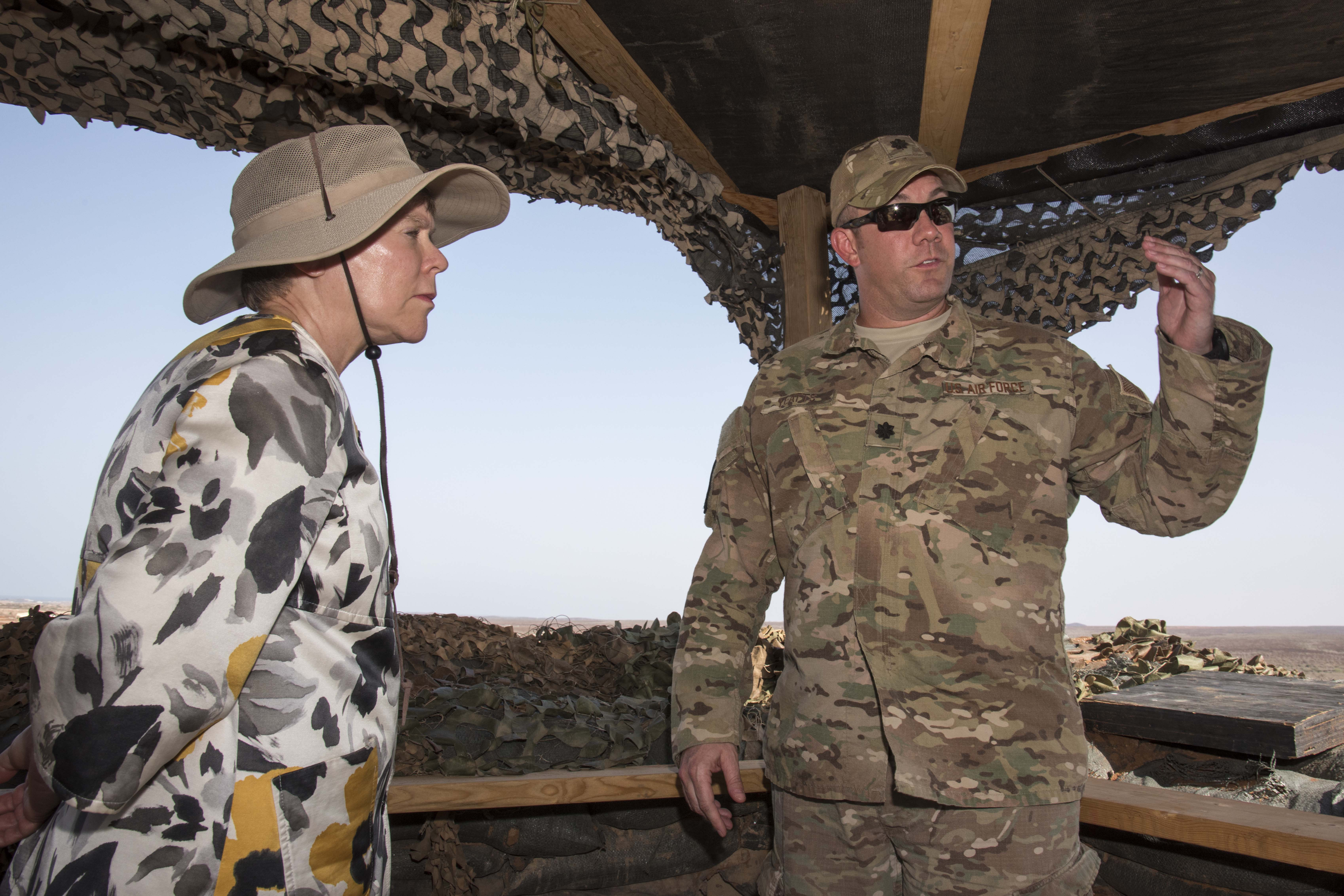 U.S. Air Force Lt. Col. Otis Yeatts, 870th Air Expeditionary Squadron commander, shows Under Secretary of State for Arms Control and International Security Rose Gottemoeller, a view from one of the perimeter posts at Chebelley Airfield, Djibouti, Nov. 14, 2015. Gottemoeller toured Chebelley and Camp Lemonnier as part of her orientation to the U.S. presence in Africa.  As Under Secretary, Gottemoeller advises the Secretary of State on arms control, nonproliferation and disarmament.