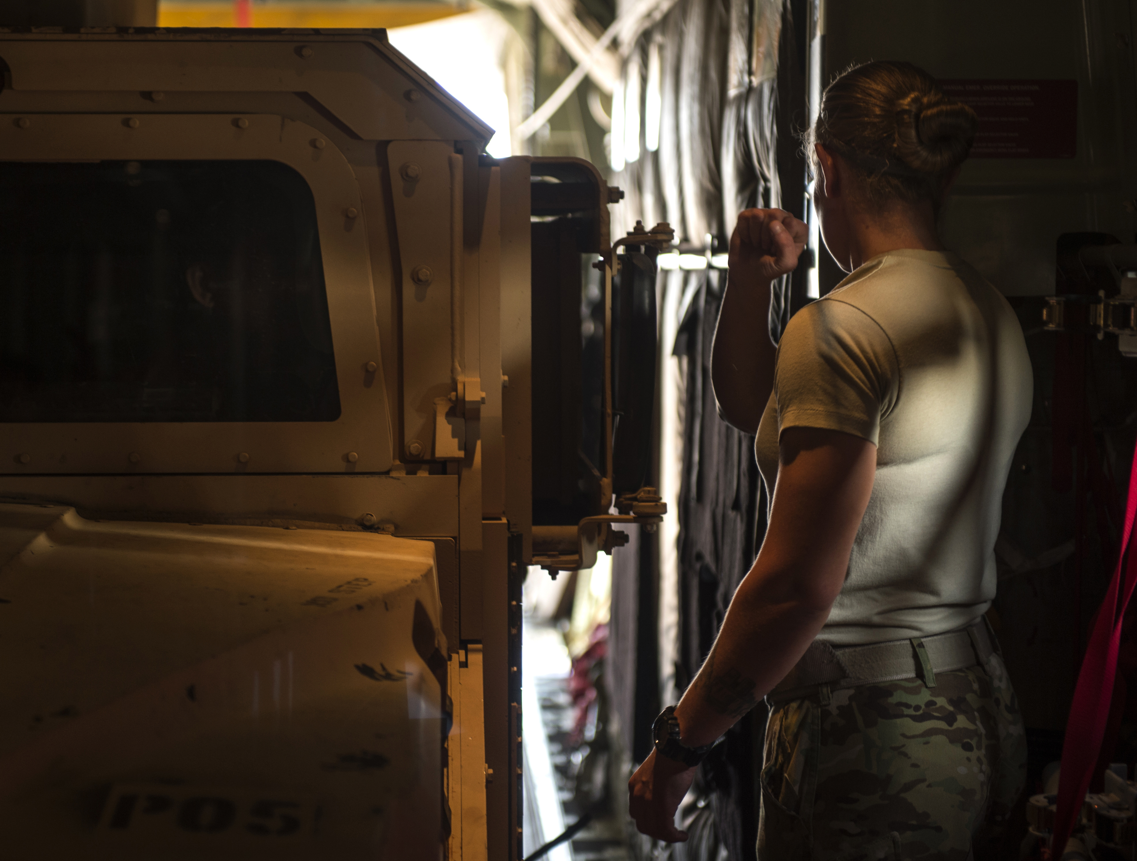 Staff Sgt. Whitney Woolverson, 75th Expeditionary Airlift Squadron loadmaster, directs a Charlie Co. 2-124 up-armored Humvee into a C-130J Super Hercules Nov. 24, 2015, at Camp Lemonnier, Djibouti. The vehicle and additional cargo were delivered to Task Force Seminole of the Florida Army National Guard, which is deployed to a forward operating location in support of the Combined Joint Task Force-Horn of Africa mission. (U.S. Air Force photo by Senior Airman Peter Thompson)