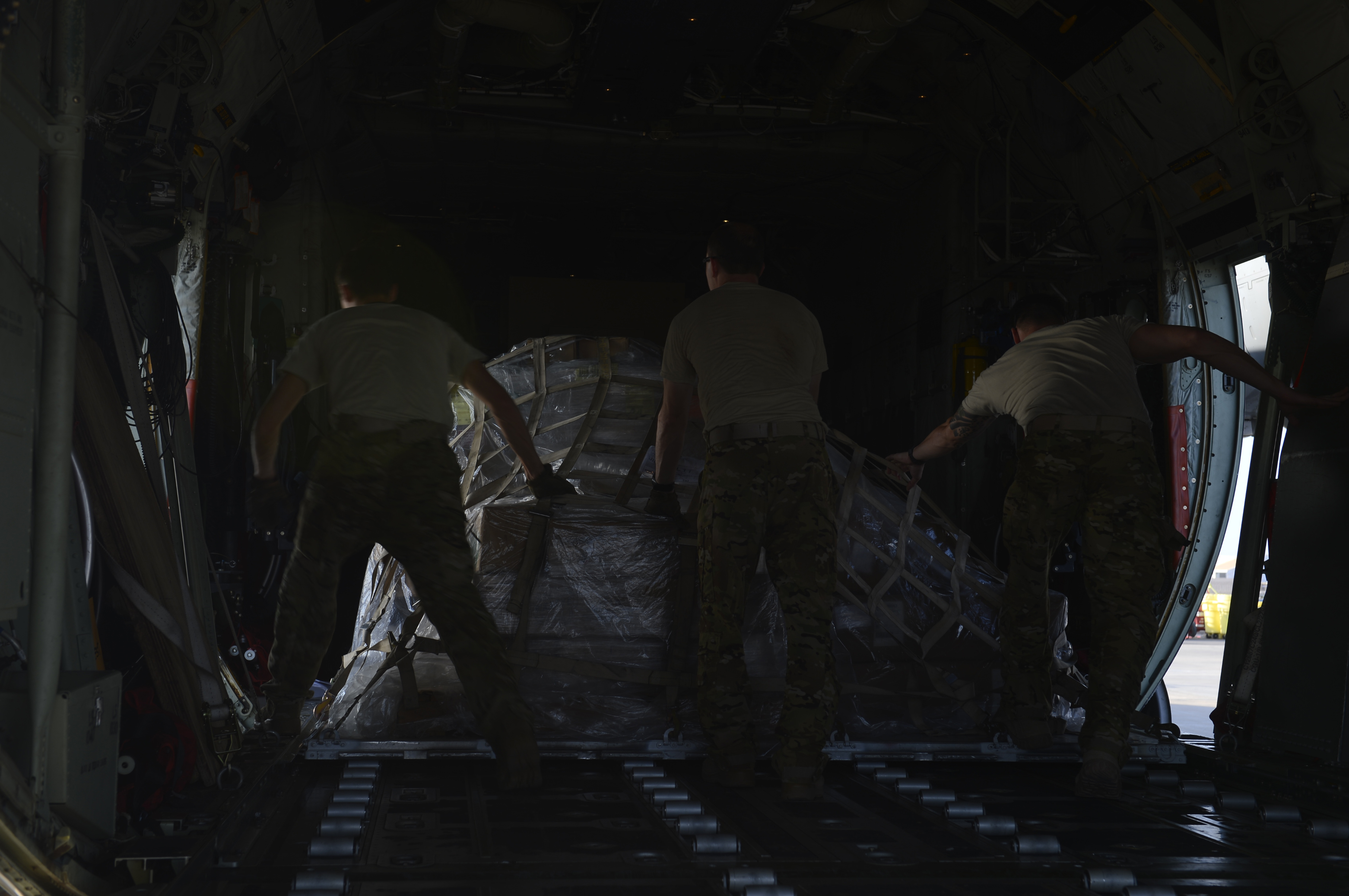 Airmen from the 75th Expeditionary Airlift Squadron push a pallet of equipment into a C-130J Super Hercules Nov. 24, 2015, at Camp Lemonnier, Djibouti. The flexible design of the C-130J enables it to be configured for many different missions, including airlift, air-ground and aeromedical evacuation. (U.S. Air Force photo by Senior Airman Peter Thompson)