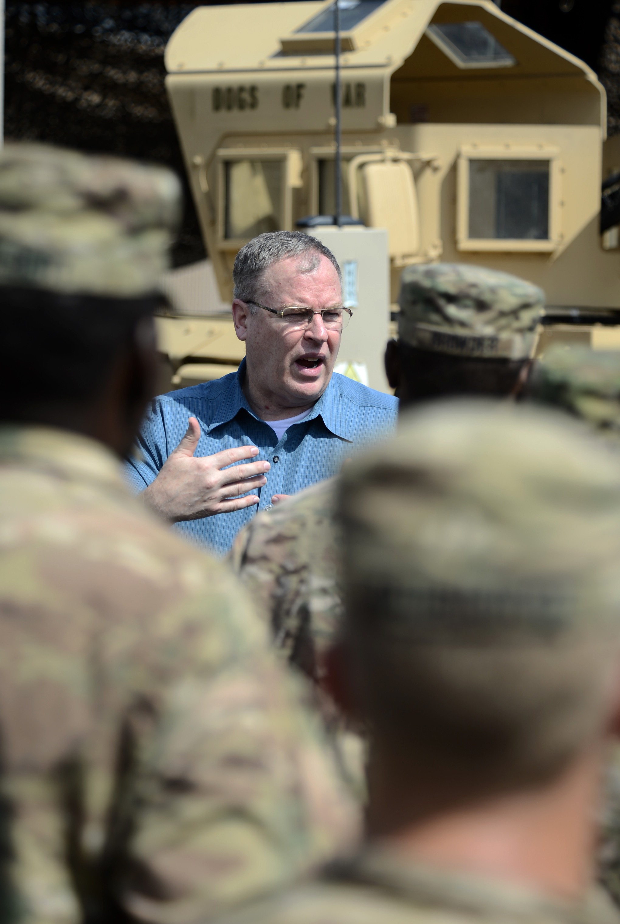 Deputy Secretary of Defense Bob Work speaks with soldiers from Delta Co. 2-124 of the Florida Army National Guard Nov. 26, 2015, at Camp Lemonnier, Djibouti. During his visit to the camp, Work met with members of the quick response force to thank them and other camp service members for their service during the Thanksgiving holiday. (U.S. Air Force photo by Senior Airman Peter Thompson)