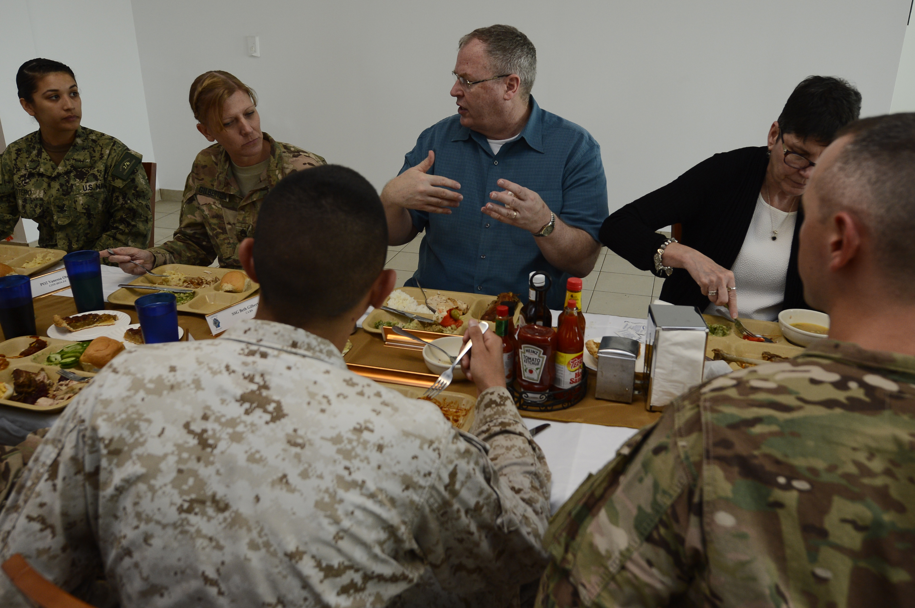Deputy Secretary of Defense Bob Work speaks with NCOs from Camp Lemonnier, Djibouti, Nov. 26, 2015. After visiting much of the base, Work took the opportunity to sit down and eat a Thanksgiving meal with members of the camp. The group discussed changes across the Department of Defense and their deployment experiences. (U.S. Air Force photo by Senior Airman Peter Thompson)