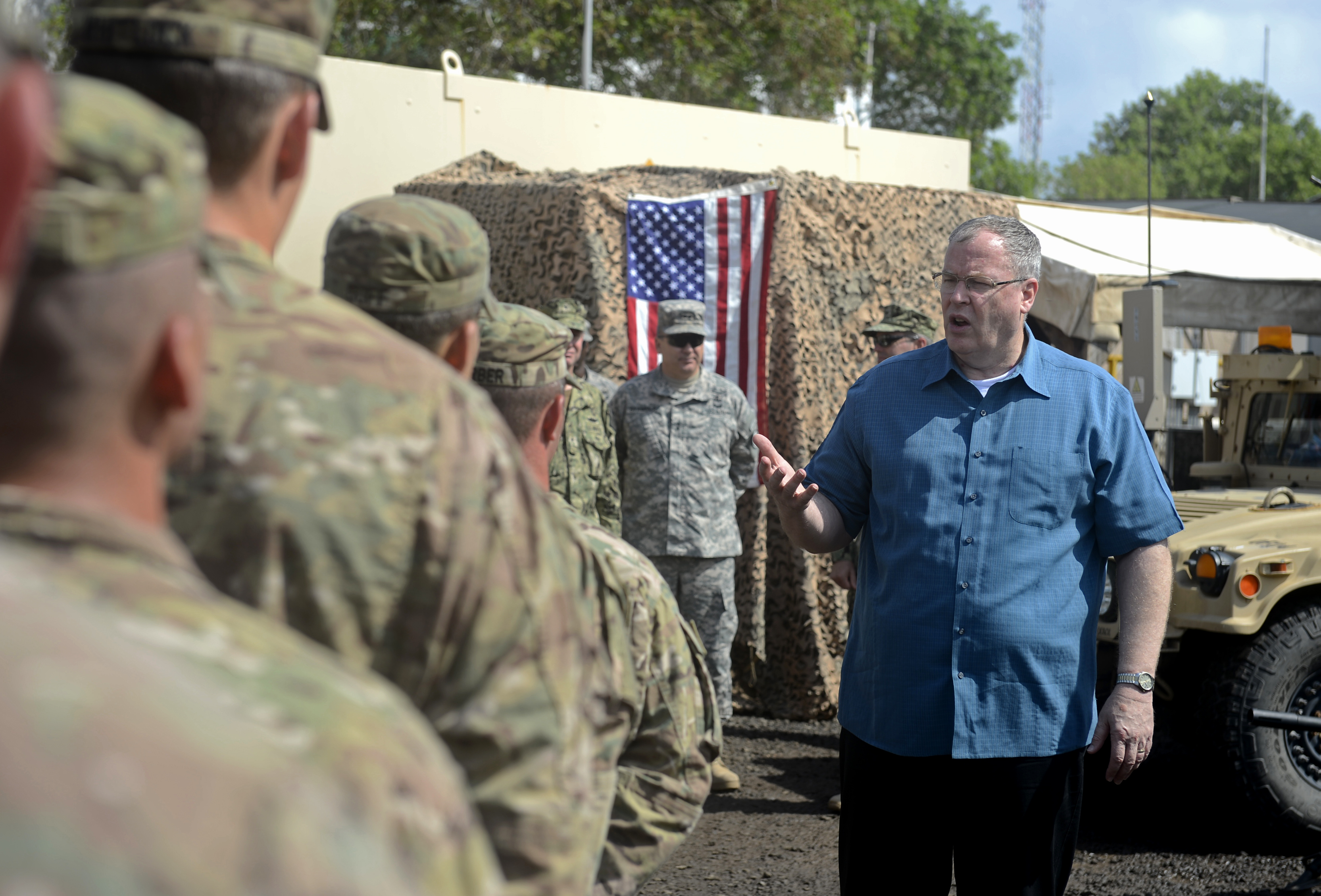 Deputy Secretary of Defense Bob Work speaks with soldiers from Delta Co. 2-124, Florida Army National Guard Nov. 26, 2015, at Camp Lemonnier, Djibouti. While visiting the quick response force unit, Work discussed changes across the Department of Defense and answered questions from many of the soldiers. (U.S. Air Force photo by Senior Airman Peter Thompson)