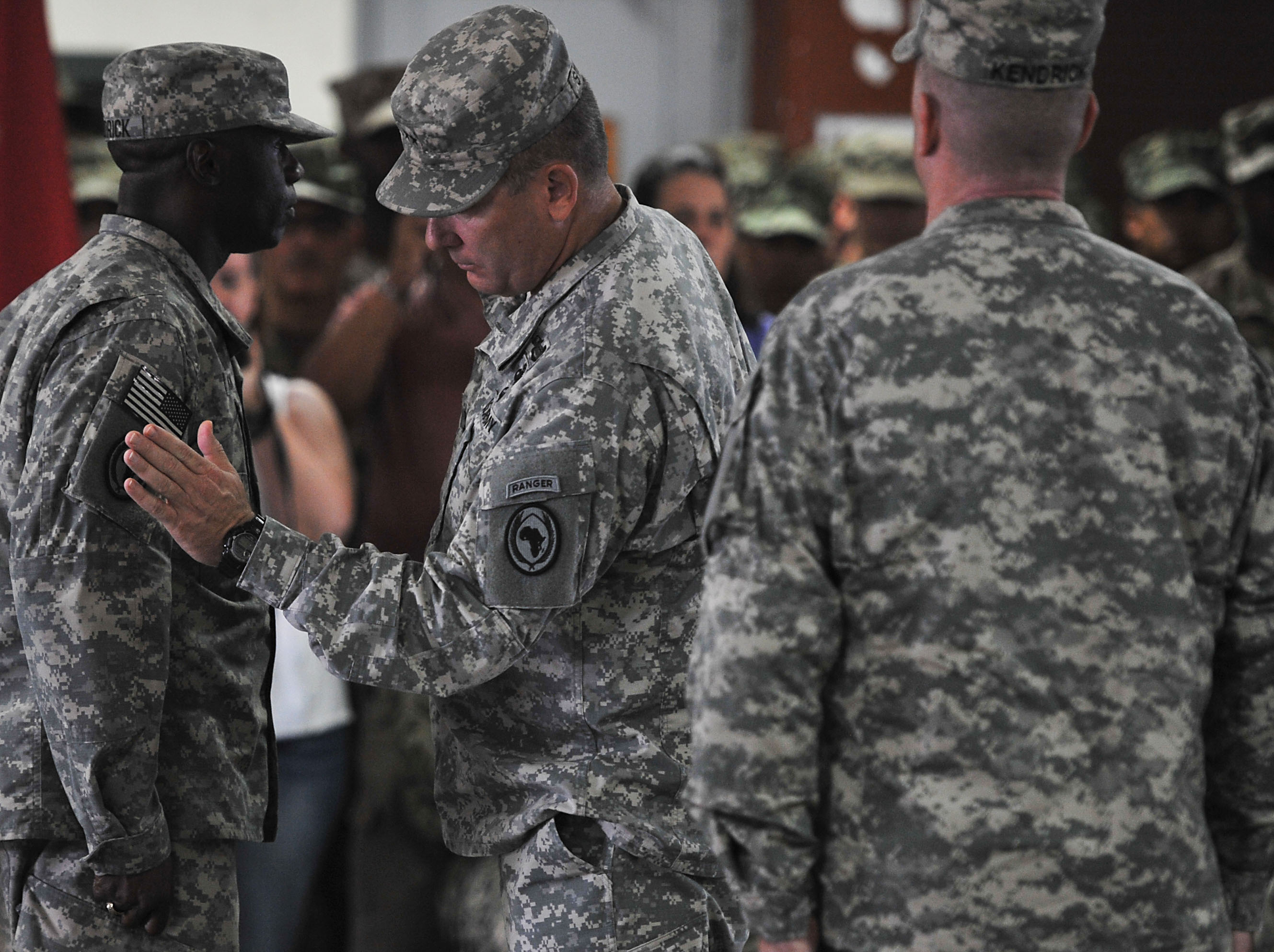 Maj. Gen. Mark Stammer, Combined Joint Task Force-Horn of Africa commanding general, presents Command Sgt. Maj. Butler Kendrick Jr. with the U.S. Africa Command combat patch during a ceremony at Camp Lemonnier, Djibouti, Nov. 28, 2015. The soldiers assigned to CJTF-HOA are now authorized to wear the U.S. Africa Command patch for the duration of their careers. (U.S. Air Force photo by Tech. Sgt. Dan DeCook)