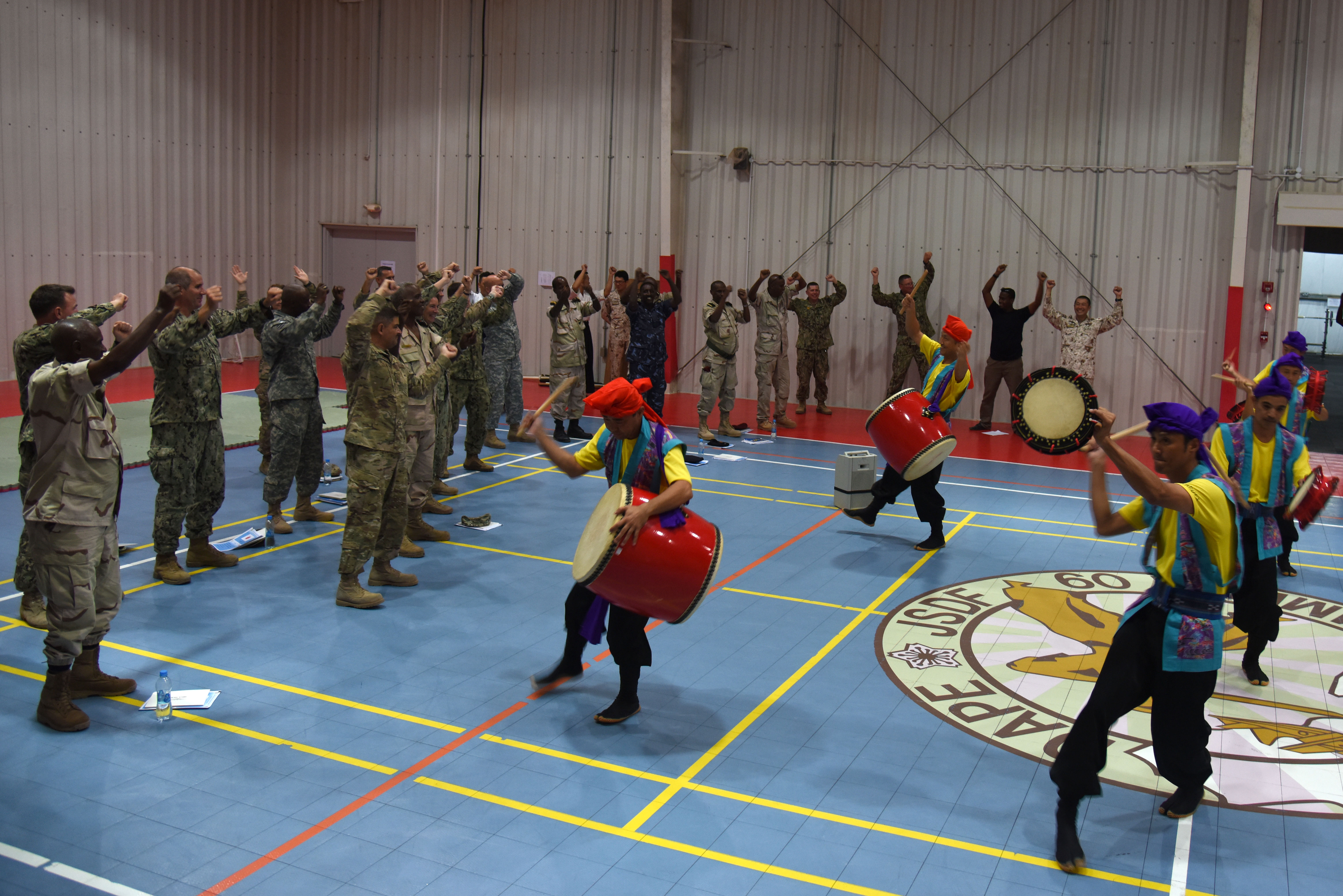 Senior enlisted members from Japan, Djibouti and the U.S. join in a traditional Eisa dance during the Joint Forces Senior Enlisted Professional Development Course at the Japan base in Djibouti, Nov. 24, 2015. Eisa is a traditional dance, unique to Okinawa, the southernmost prefecture of Japan, which is performed during seasonal festivals to honor and thank their ancestors. (U.S. Air Force photo by Staff Sgt. Victoria Sneed)