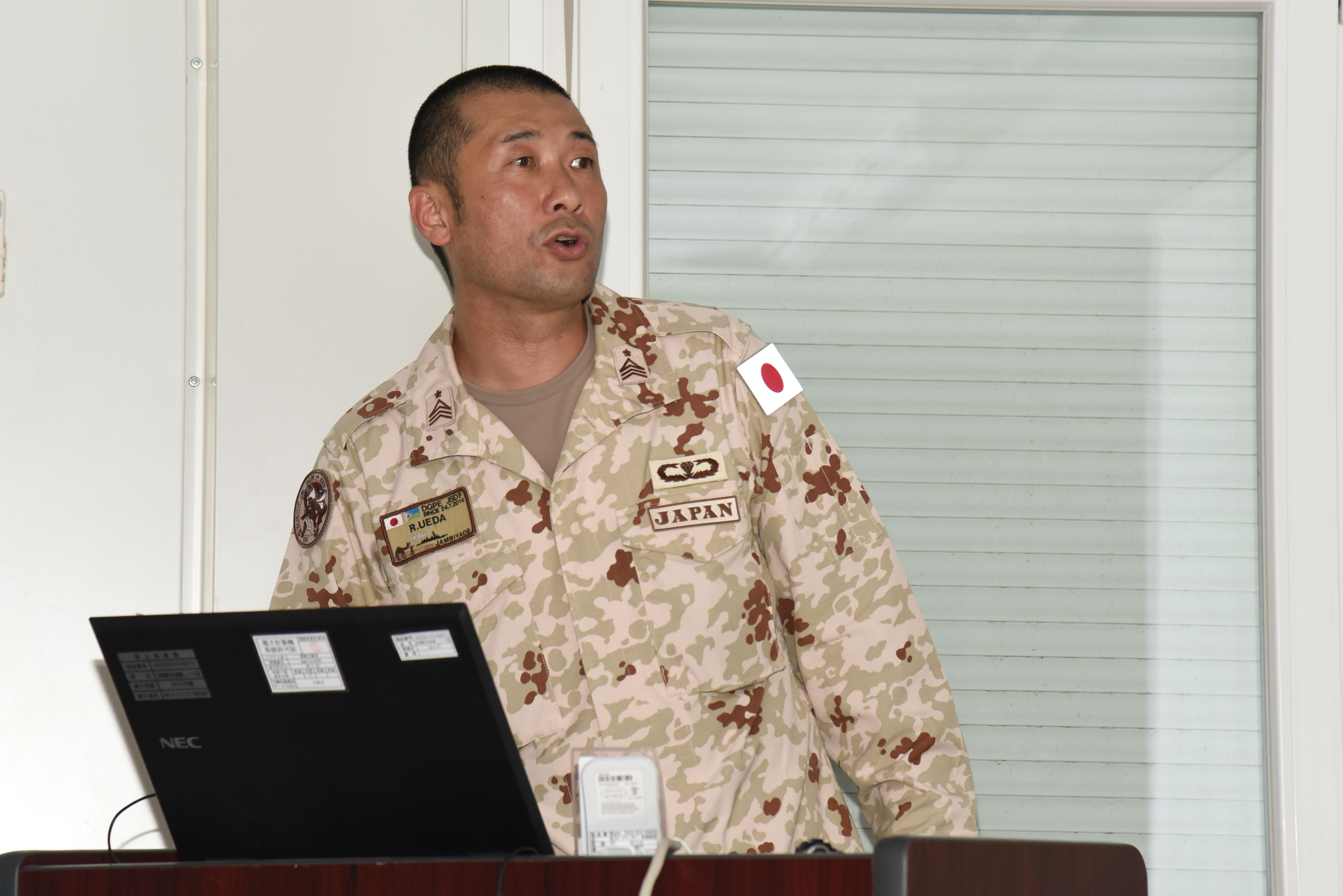 Japan Ground Self-Defense Force Command Sgt. Maj. Ryuichi Ueda introduces the basics of Japanese culture to attendees of the Joint Forces Senior Enlisted Professional Development Course at the Japanese base in Djibouti, Nov. 24, 2015. Military members from the U.S. and Djibouti learned about Japan's location, climate, history, and unique cultural customs. (U.S. Air Force photo by Staff Sgt. Victoria Sneed)