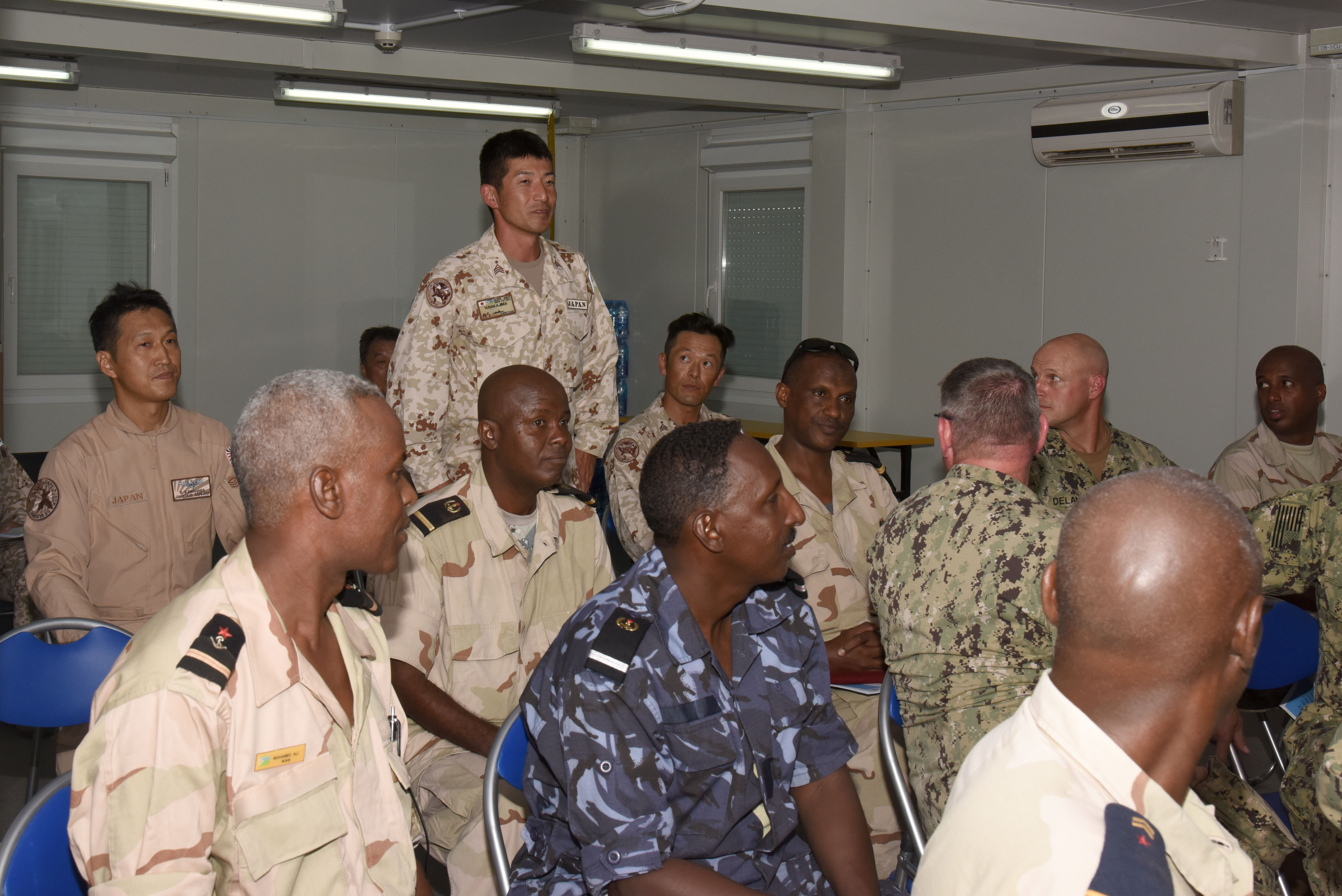 Japan Ground Self-Defense Force Sgt. Maj. Hisashi Nakajima introduces himself to other attendees of the Joint Forces Senior Enlisted Professional Development Course at the Japan base in Djibouti, Nov. 24, 2015. Members from Japan, Djibouti and the U.S. gathered to learn about Japanese history, culture and mission to help attendees better understand their multicultural allies. (U.S. Air Force photo by Staff Sgt. Victoria Sneed)