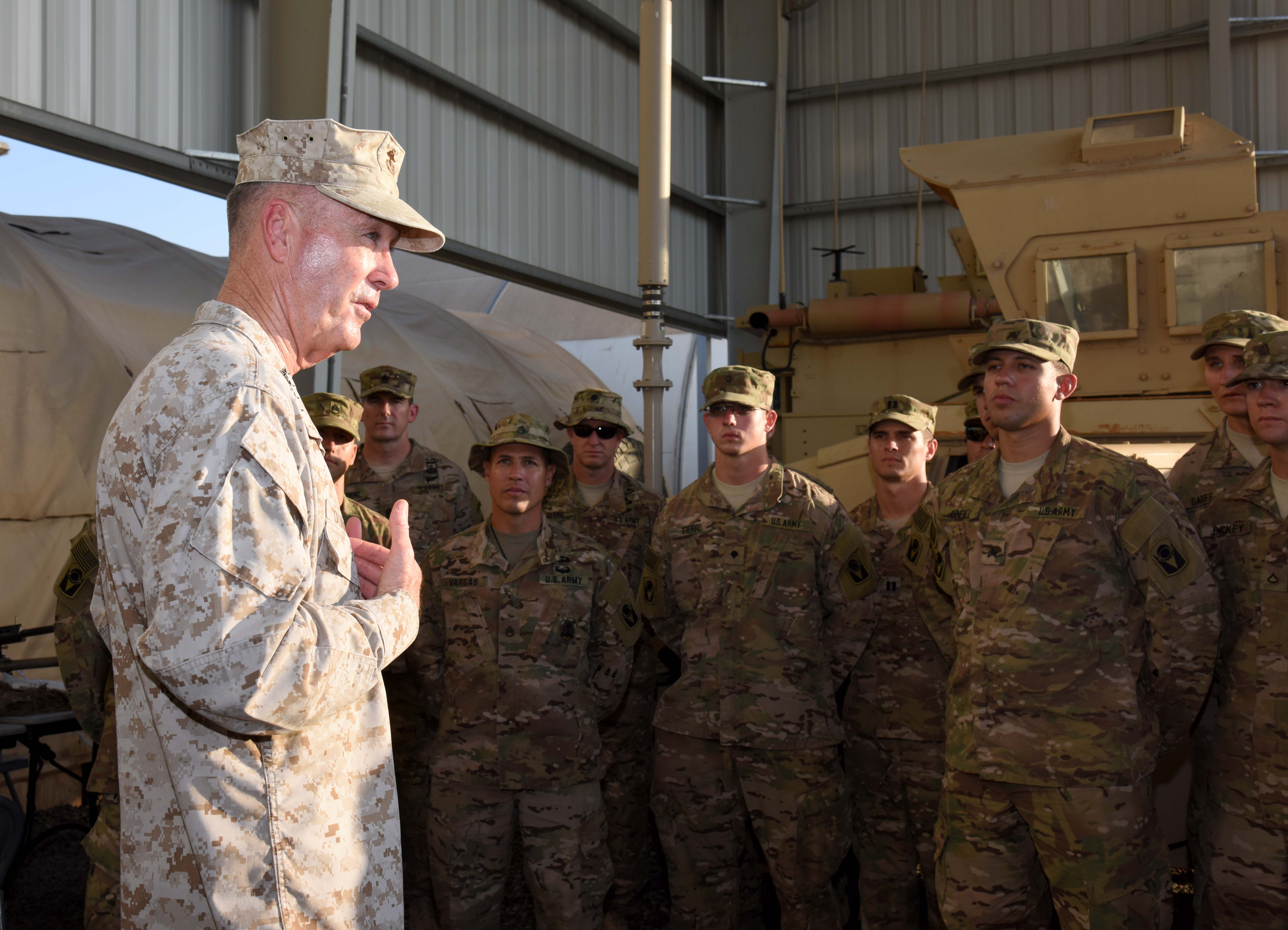 Marine Corps Gen. Joseph Dunford, Chairman of the Joint Chiefs of Staff, speaks to soldiers from 2nd Battalion, 124th Infantry Regiment (Seminole Battalion) during his visit to Camp Lemonnier, Djibouti, Dec. 6, 2015. The Chairman took time to thank the Soldiers, Sailors, Airmen and Marines for their contributions to enabling East African partners to fight violent extremist organizations in the region. (U.S. Air Force photo by Staff Sgt. Victoria Sneed)