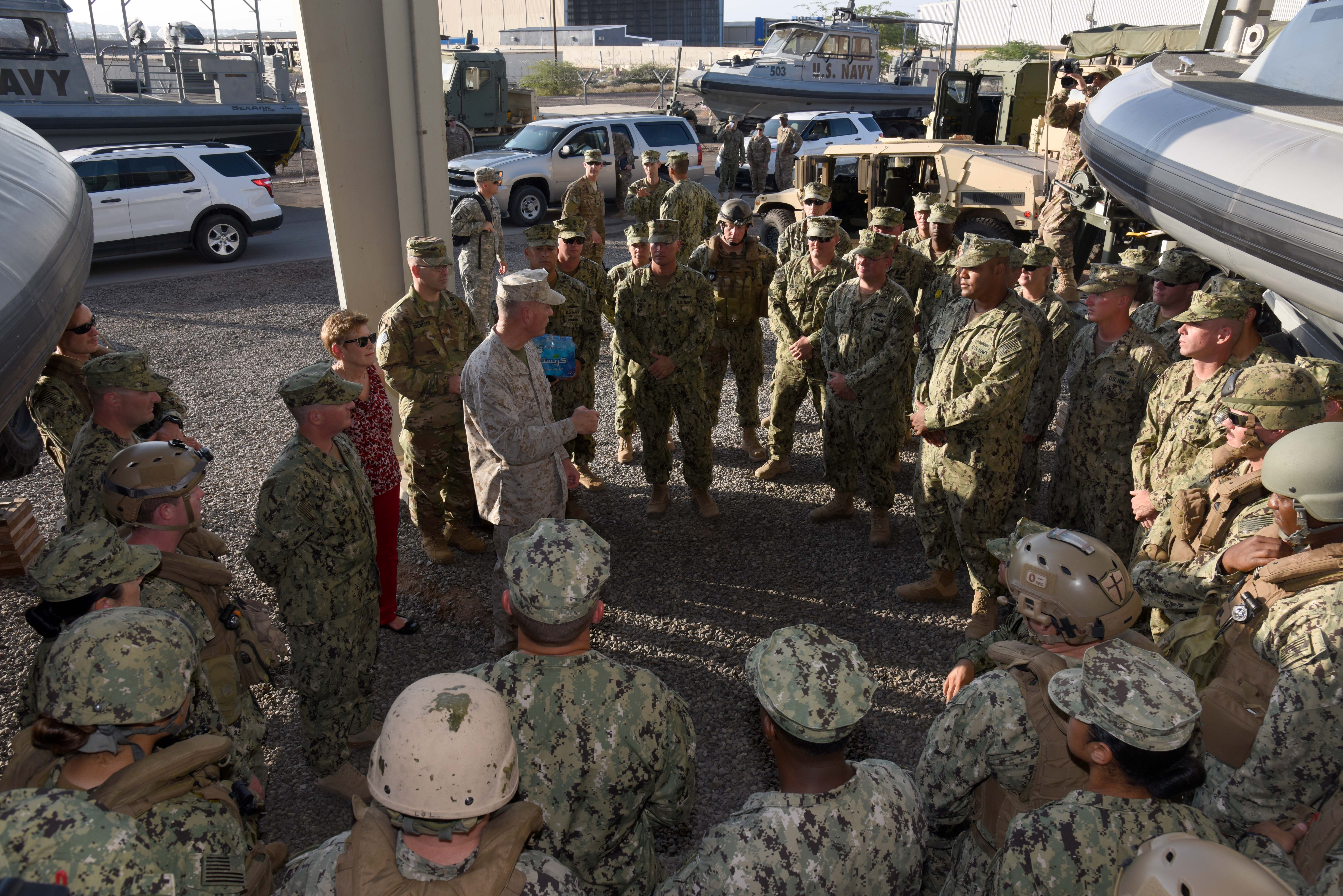 Marine Corps Gen. Joseph Dunford, Chairman of the Joint Chiefs of Staff, speaks to sailors from the Coastal Riverine Squadron 10 during his visit as part of the 2015 USO entertainment troupe tour at Camp Lemonnier, Djibouti, Dec. 6, 2015. The Riverines' primary mission is to conduct maritime security operations across all phases of military operations by defending high value assets, critical maritime infrastructure, ports and harbors - both inland and on coastal waterways. (U.S. Air Force photo by Staff Sgt. Victoria Sneed)
