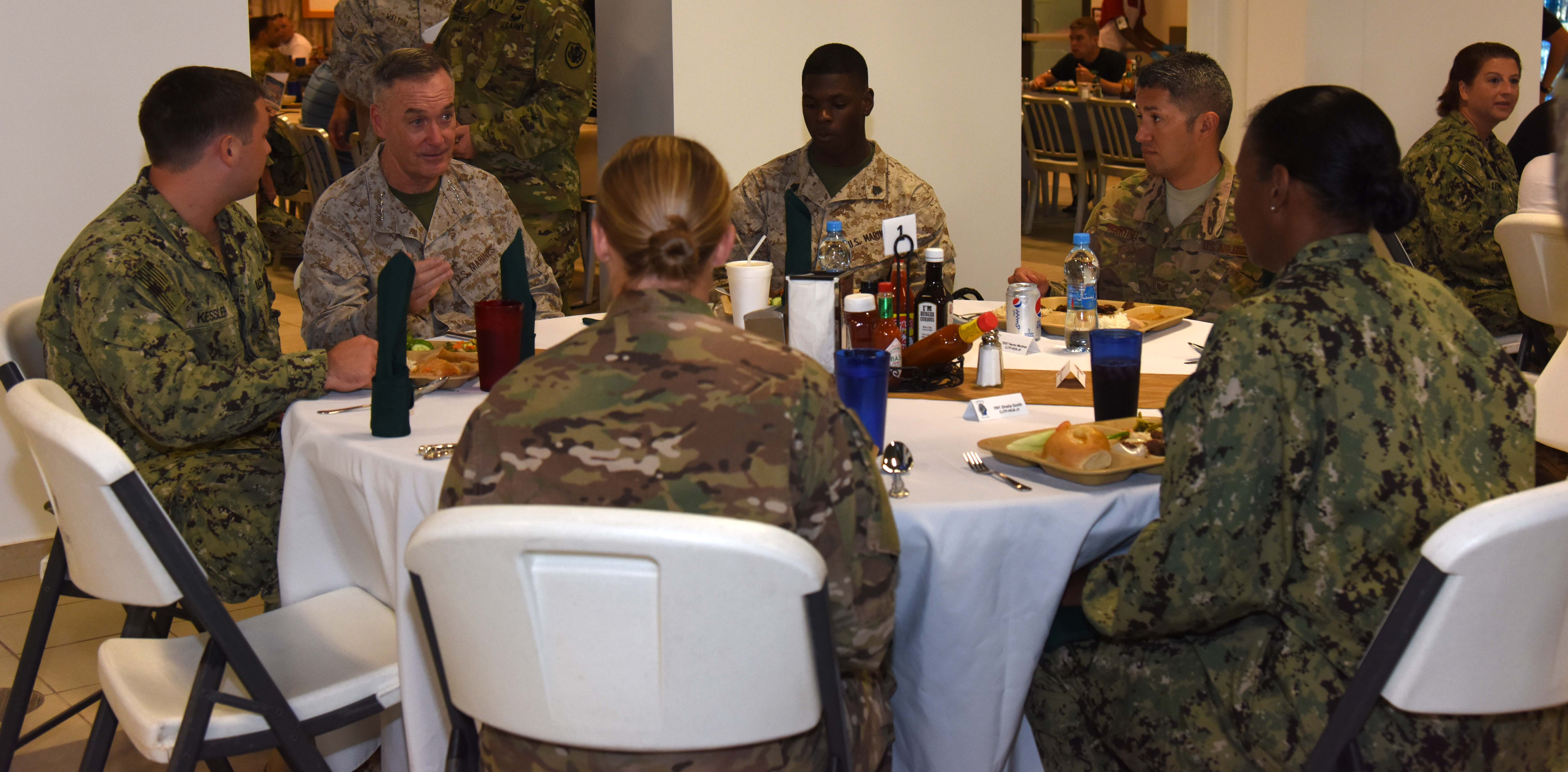 Marine Corps Gen. Joseph Dunford, Chairman of the Joint Chiefs of Staff, shares a meal with service members at Camp Lemonnier, Djibouti, Dec. 6, 2015. The chairman took time, while touring as senior leader for the 2015 USO entertainment troupe tour, to thank service members for their dedication and sacrifice during the holiday season. (U.S. Air Force photo by Staff Sgt. Victoria Sneed)