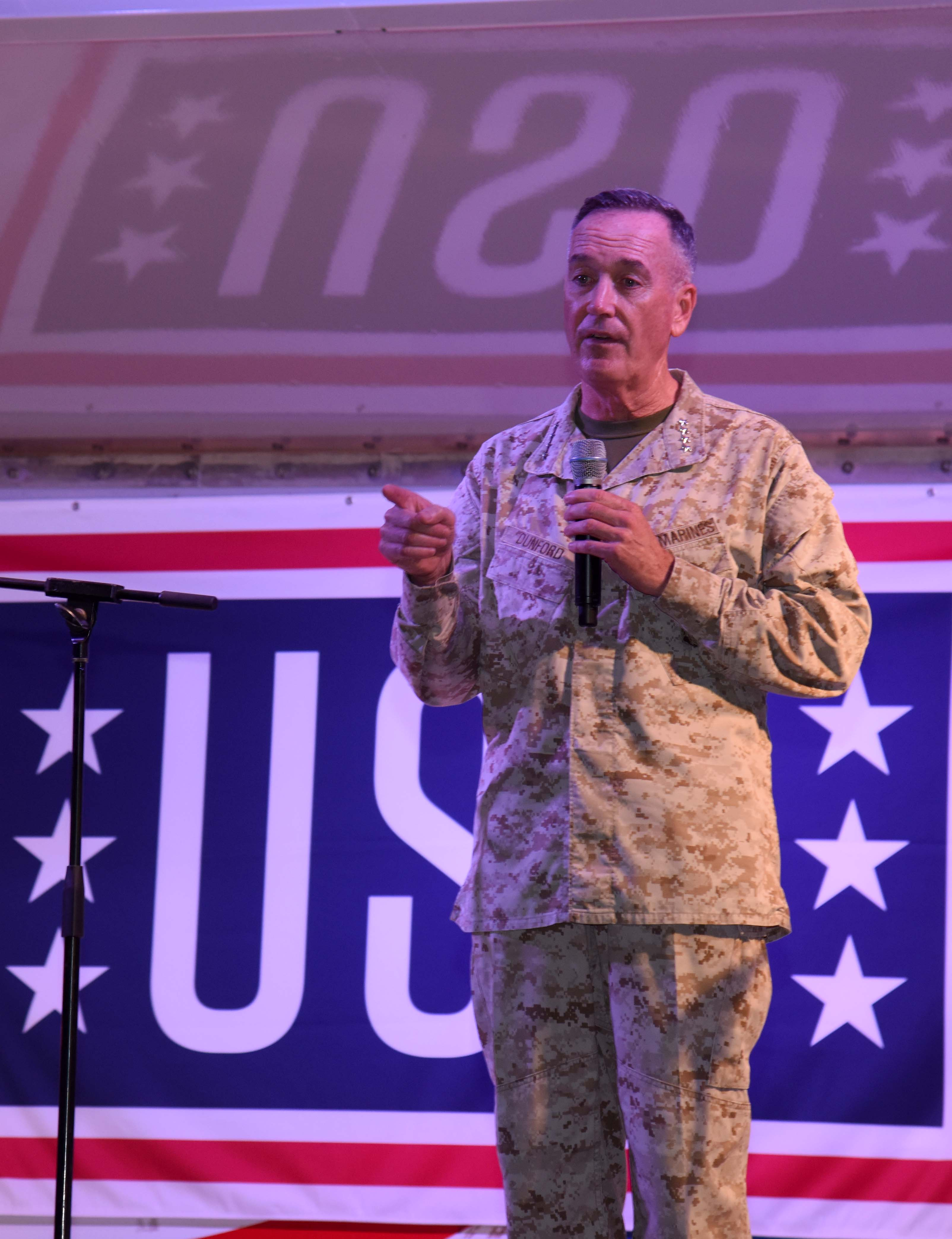Marine Corps Gen. Joseph Dunford, Chairman of the Joint Chiefs of Staff, introduces the hosts of the 2015 USO Entertainment Troupe during their visit to Camp Lemonnier, Djibouti, Dec. 6, 2015. Dunford joined the tour as the senior leader on its multi-day, three-continent trip to show service members their appreciation during the holiday season. (U.S. Air Force photo by Staff Sgt. Victoria Sneed)