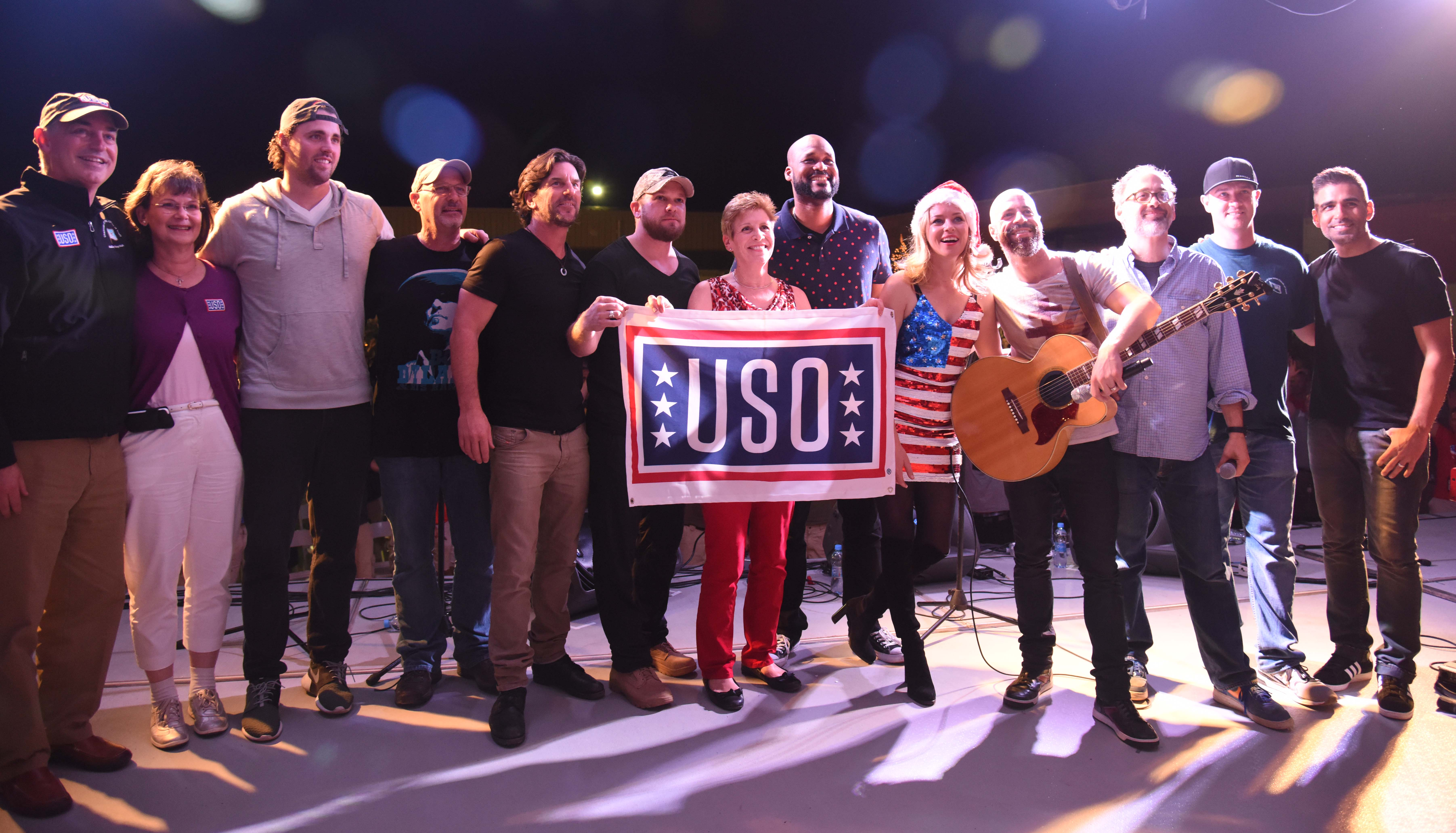 Members of the 2015 USO Entertainment Troupe pose for a photo during their trip to Camp Lemonnier, Djibouti, Dec. 6, 2015. Actress Elizabeth Banks co-hosted the tour with actor David Wain, introducing numerous acts including comedian Sydney Castillo, singers Chris Daughtry, Brett James, Bill Montana, and Kyle Jacobs, and Boston Red Sox pitchers Heath Hembree and Steven Wright. (U.S. Air Force photo by Staff Sgt. Victoria Sneed)
