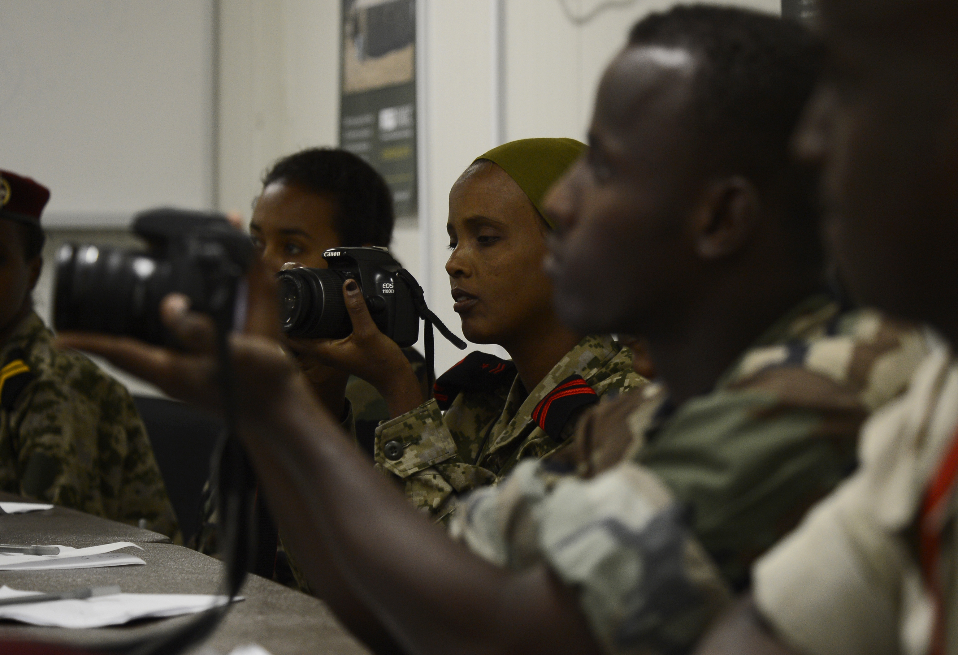 Members of the Djibouti Armed Forces (FAD) look through settings on their cameras Dec. 2, 2015, at Camp Lemonnier, Djibouti. The Combined Joint Task Force-Horn of Africa Public Affairs Office worked with eight FAD members to improve their understanding of photo and video techniques and equipment. (U.S. Air Force photo by Senior Airman Peter Thompson)