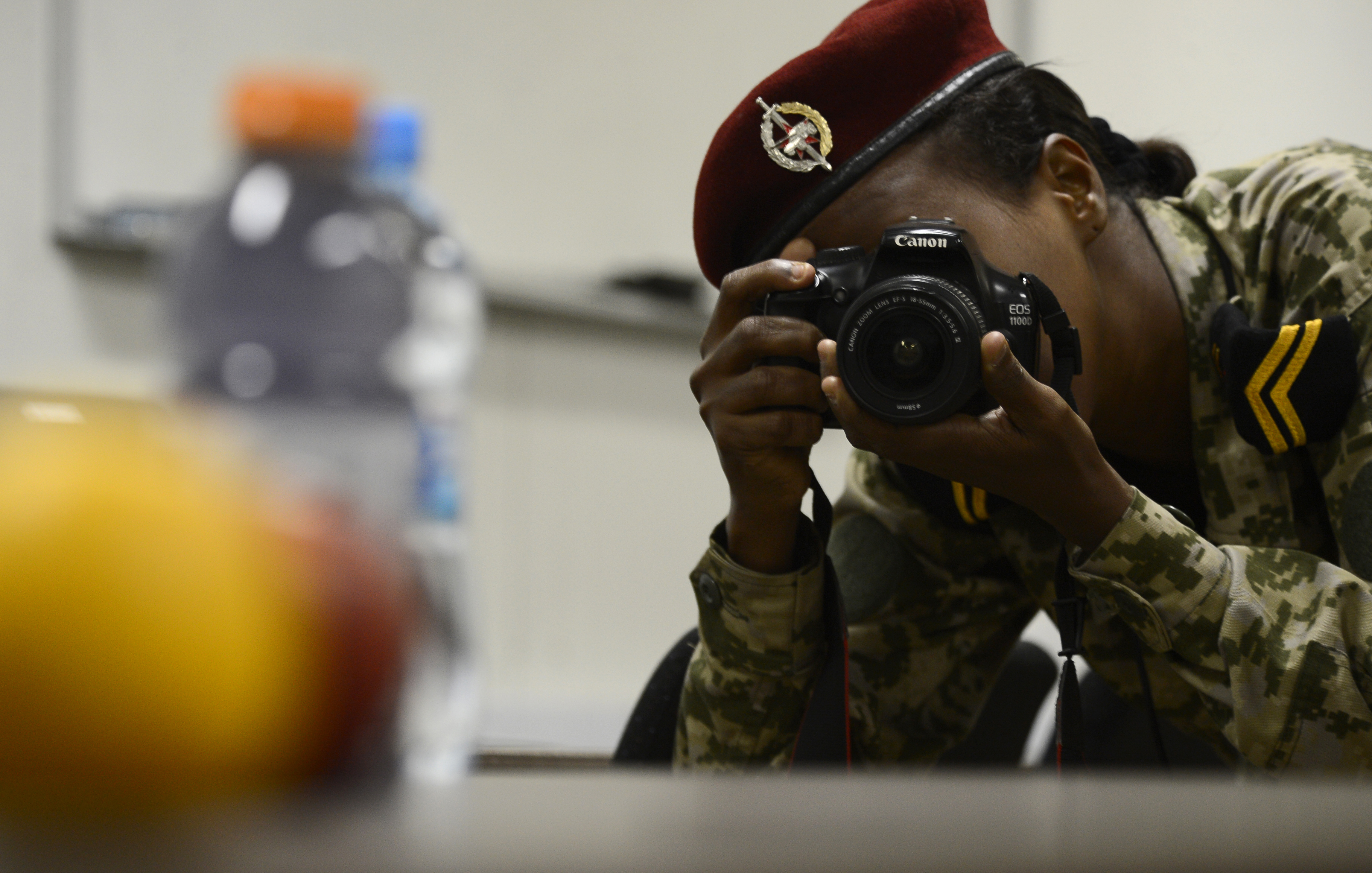 Sgt. Fatouma Gouled of the Djibouti Armed Forces (FAD) takes a photo demonstrating photography techniques Dec. 2, 2015, at Camp Lemonnier, Djibouti. The weeklong FAD public affairs engagement provided participants with information and experience needed to improve their photography and videography abilities. (U.S. Air Force photo by Senior Airman Peter Thompson)