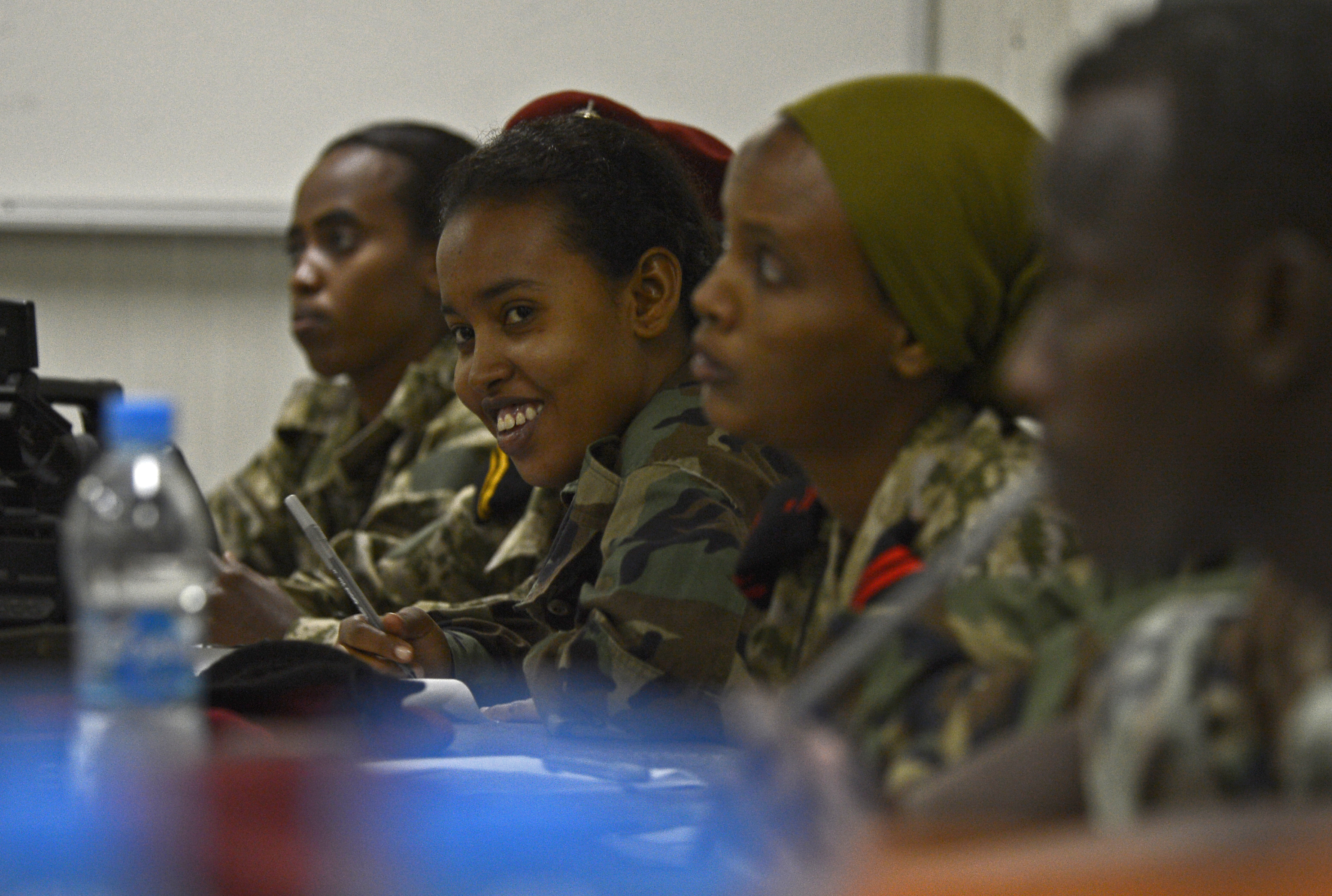 Members of the Djibouti Armed Forces (FAD) discuss photographic composition Dec. 2, 2015, at Camp Lemonnier, Djibouti. Members of Combined Joint Task Force-Horn of Africa Public Affairs Office spent a week sharing photography and videography best practices with the FAD members. (U.S. Air Force photo by Senior Airman Peter Thompson)