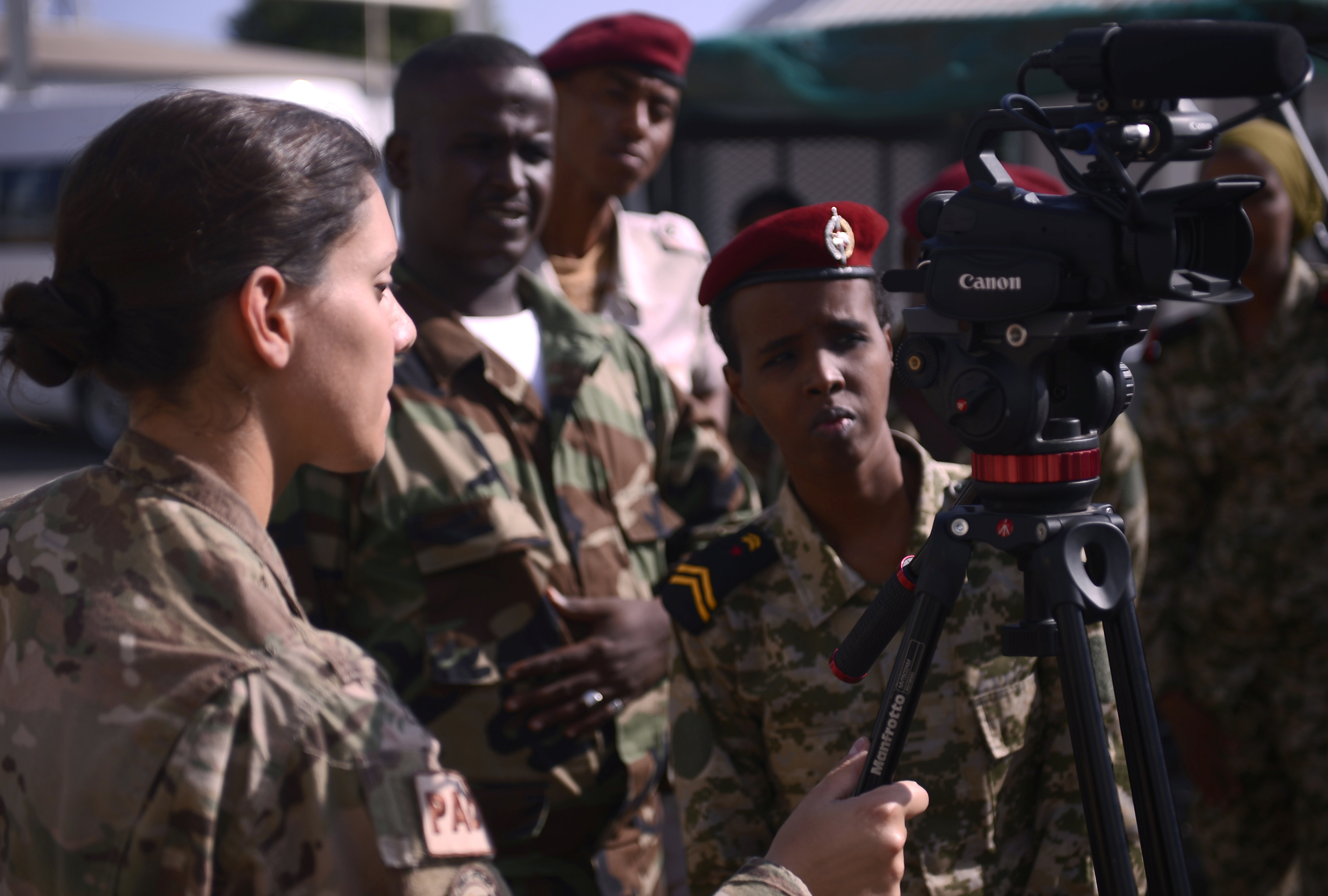 Senior Airman Nina Orlando, Combined Joint Task Force-Horn of Africa broadcast journalist, left, discusses video composition with members of the Djibouti Armed Forces (FAD) Dec. 3, 2015, at Camp Lemonnier, Djibouti. Similar to U.S. military journalists, the Djiboutian photographers and videographers gather still and video imagery for mission documentation, media distribution and operational purposes. The engagement with the FAD enabled participants to share their knowledge and experiences with each other and build relationships between the two militaries. (U.S. Air Force photo by Senior Airman Peter Thompson)