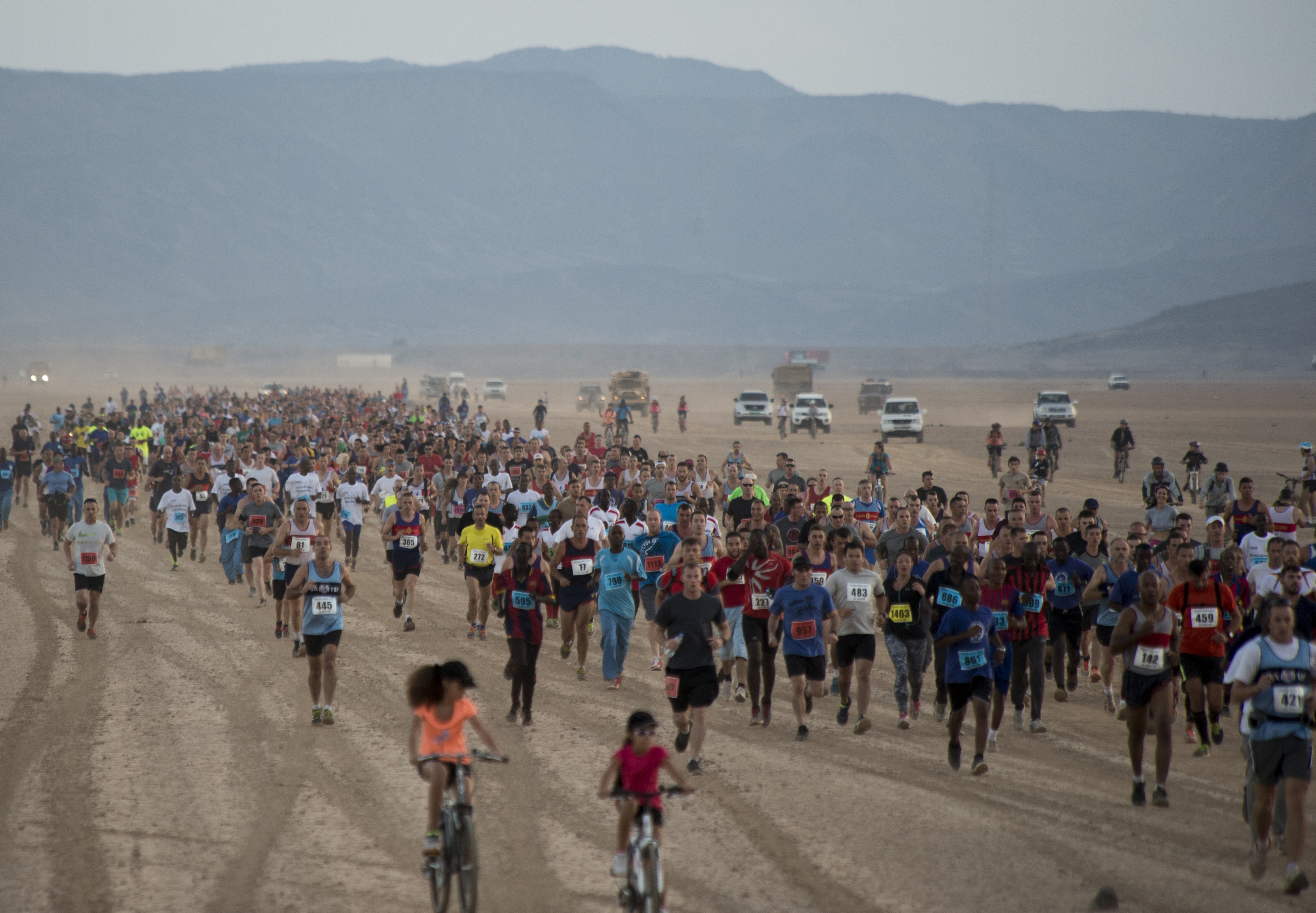 Runners make their way across the Grand Bara Desert during the Annual Grand Bara 15K race Dec. 17, 2015, in Djibouti. The Grand Bara run includes runners from American, Japanese, French and local Djiboutian militaries. (U.S. Air Force photo by Senior Airman Peter Thompson)
