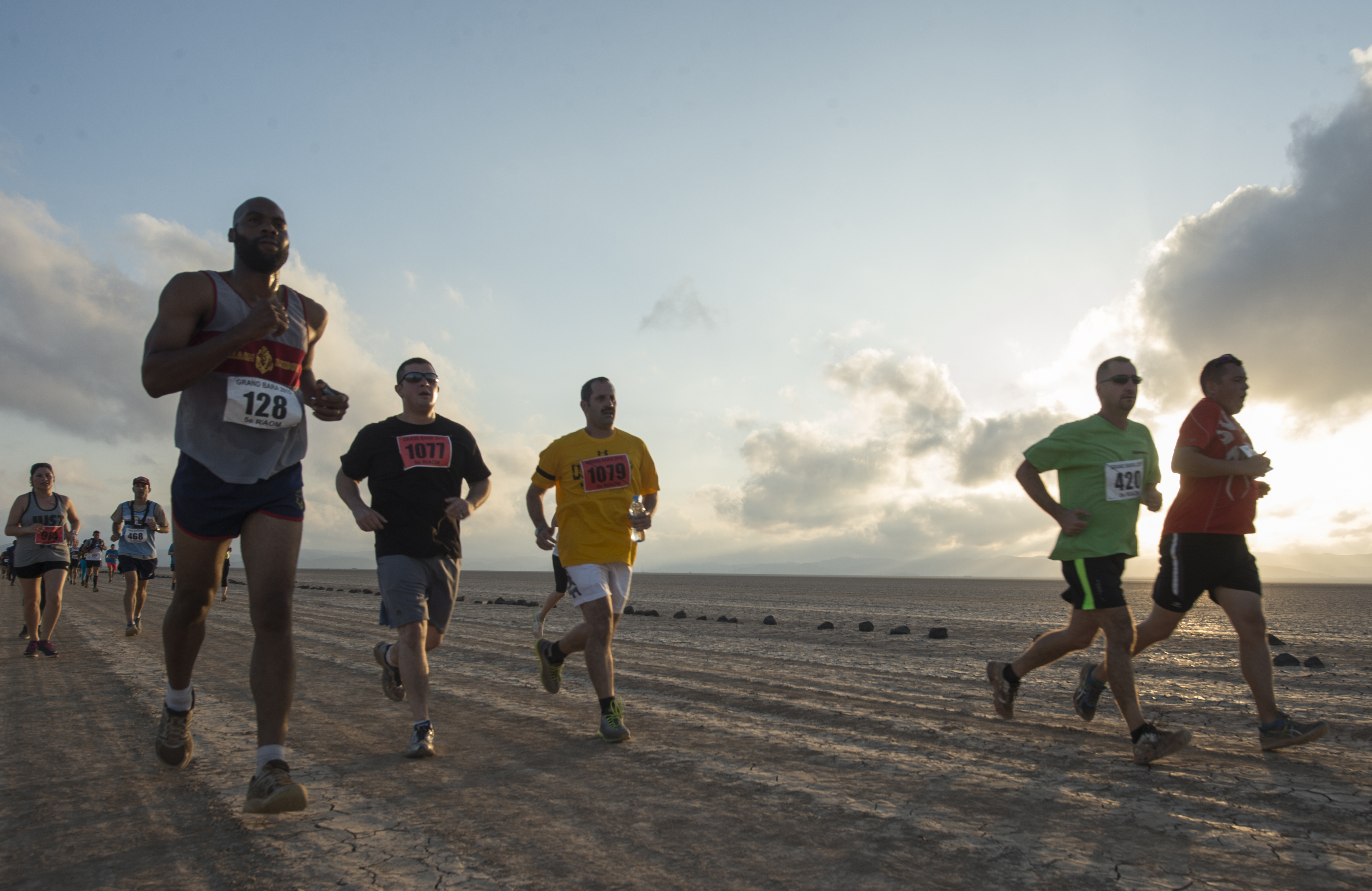 Runners make their way across the Grand Bara Desert during the Annual Grand Bara 15K race Dec. 17, 2015, in Djibouti. Most races start with a gunshot, but the Grand Bara traditionally starts with a flyover of French Mirage fighter jets. (U.S. Air Force photo by Senior Airman Peter Thompson)