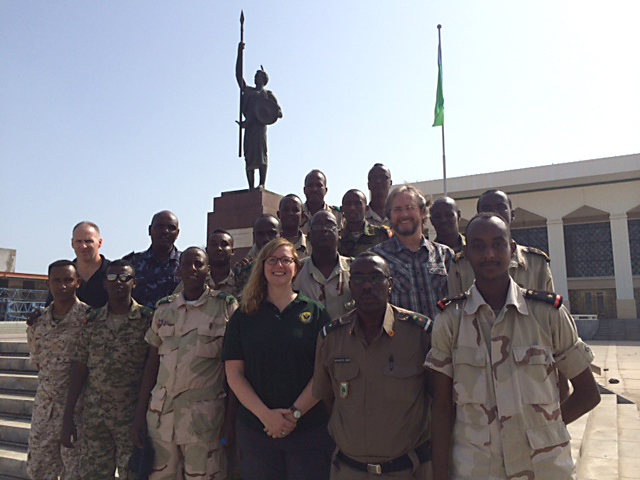 Members of a security assistance training team and the Djiboutian Armed Forces (FAD) pose for a group photo, Dec. 12, 2015 at the People's Palace in Djibouti. The team conducted a three-week security assistance training session in order to help the FAD combat violent extremist organizations across East Africa. (U.S. Air Force photo by Tech. Sgt. Dan DeCook)