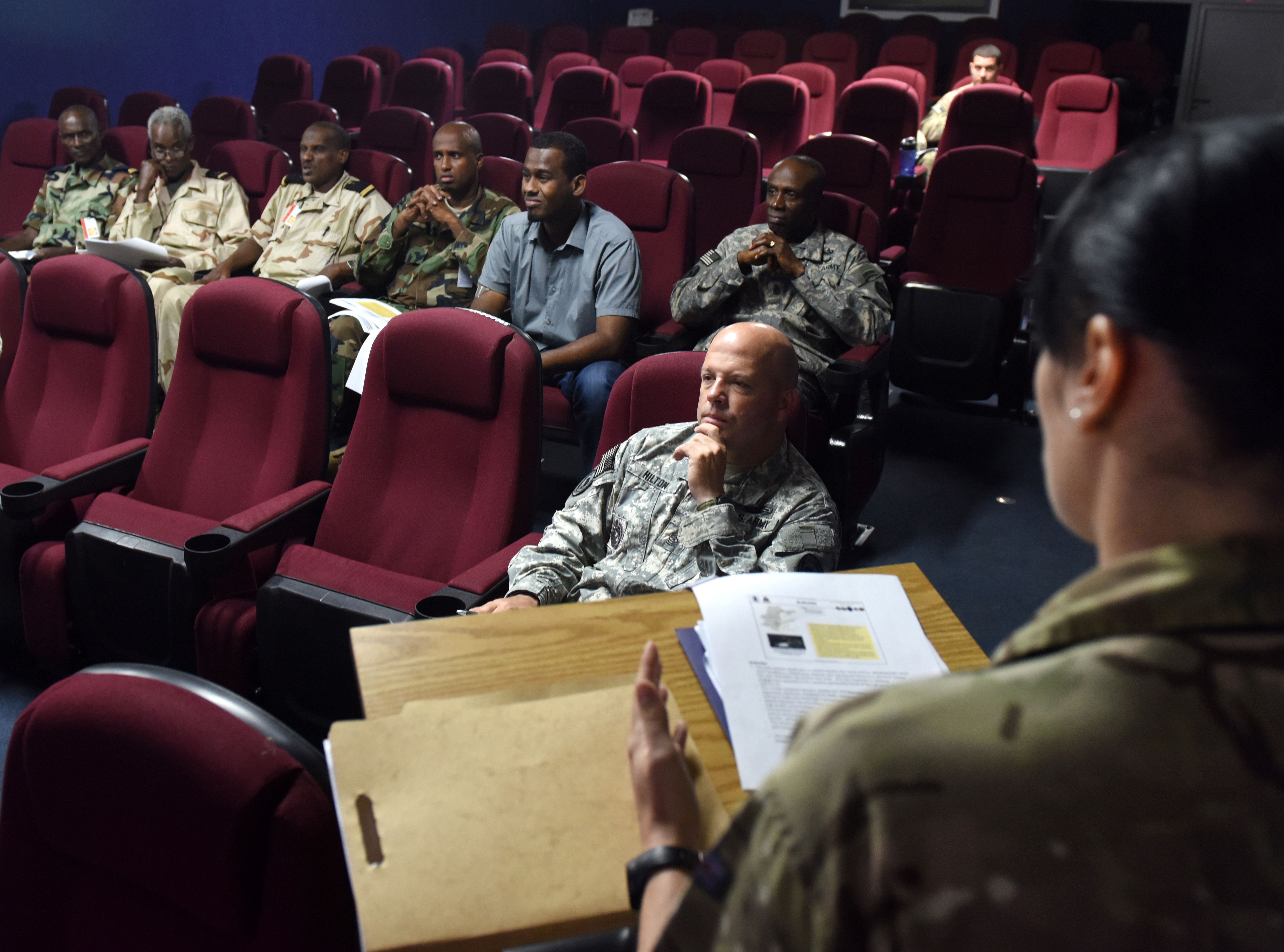 Royal Army Sgt. Victoria McIndewar, British Intelligence Corps, briefs senior enlisted leaders from Combined Joint Task Force-Horn of Africa and the Djibouti Armed Forces Dec. 29, 2015, at Camp Lemonnier, Djibouti. The visit consisted of two briefings covering current conditions in Somalia and the African Union mission to neutralize Al-Shabaab and stabilize the country. (U.S. Air Force photo by Staff Sgt. Kate Thornton)