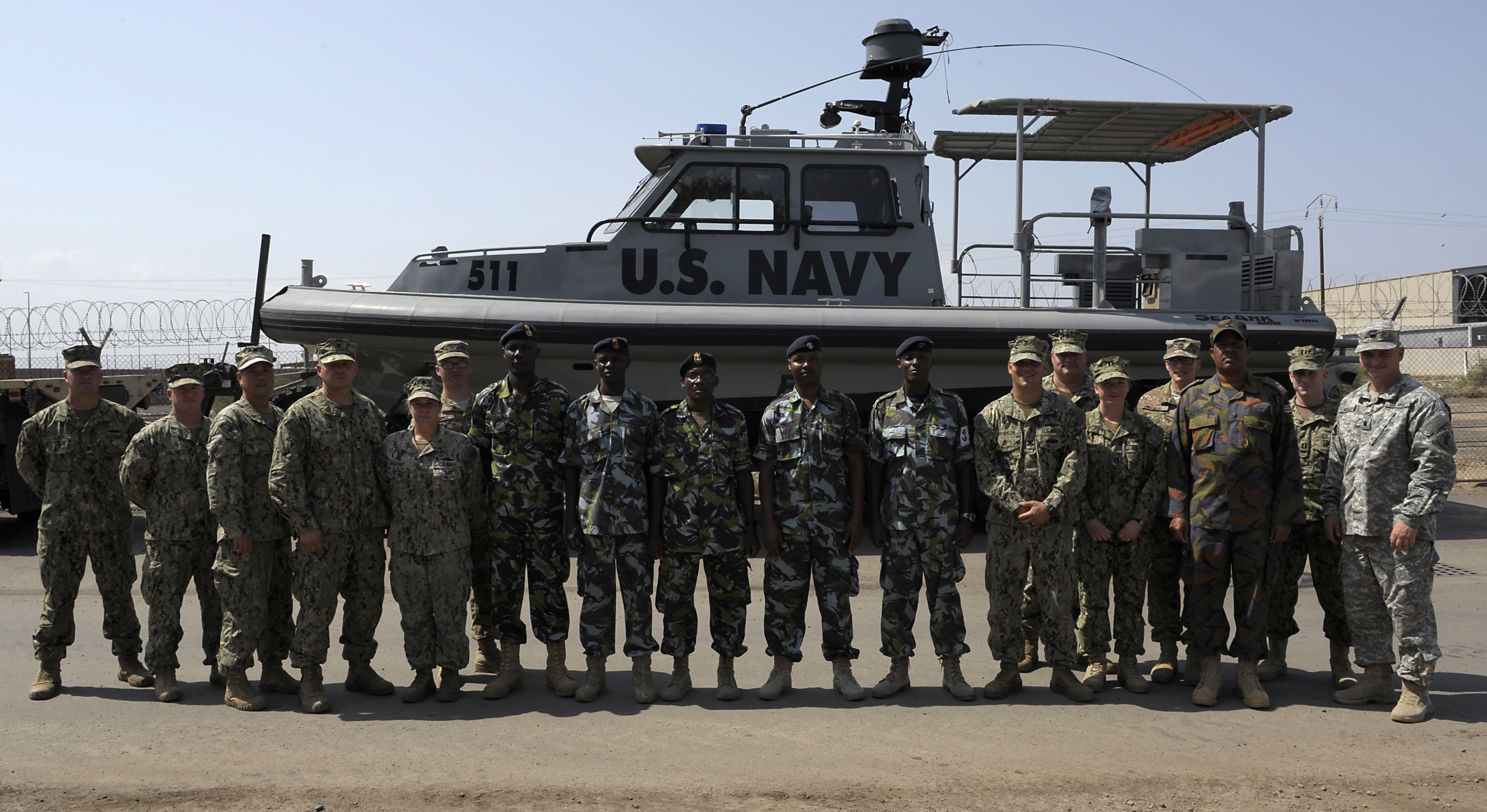 Members of the Kenya Defence Forces Navy and Coastal Riverine Squadron 10 pose for a photo after the conclusion of a two-day maintenance and organization seminar held at Camp Lemonnier, Djibouti, Jan. 18, 2016. The seminar was organized to share best practices on maintenance, organization, troubleshooting, and casualties while underway. (U.S. Air Force photo by Tech. Sgt. Dan DeCook)